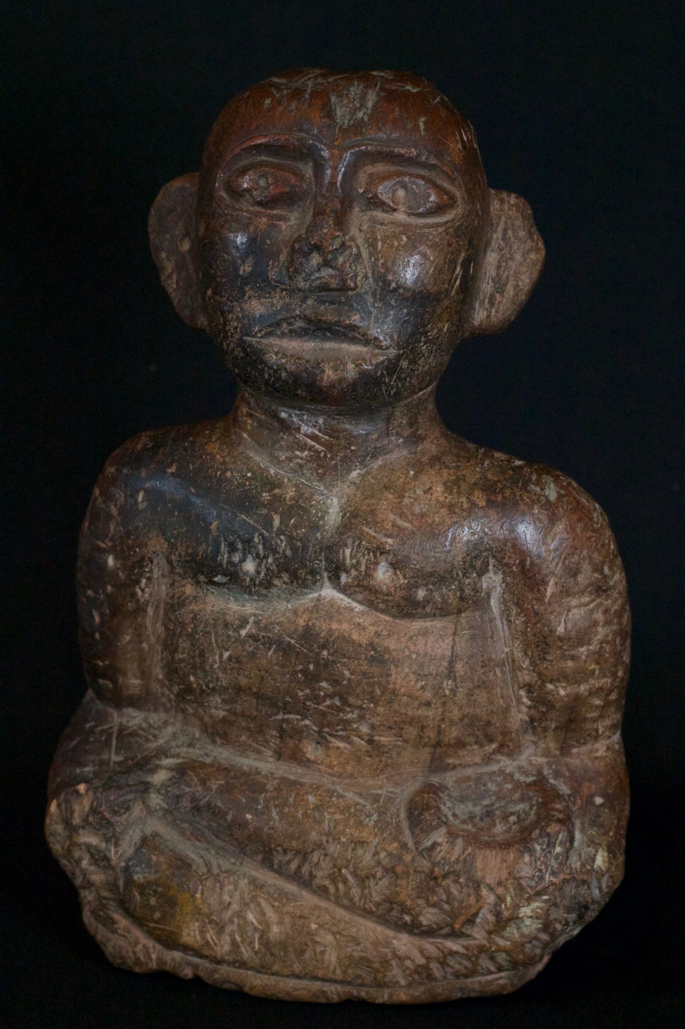 """'Pangulubalang' Shaman Figure (exceptionally rare), Sumatra, Indonesia, Batak, Simalungun, Mid 16th to 17th c, Stone, with patina They are specifically made by the shaman and embodied with a powerful spirit slave. They are used in conjunction with a magical substance, pupuk - a magical substance which is the embodiment of earthly suffering, destruction, hate and anger - which required special ingredients and a long and intricate preparation ritual. The purpose of this was to imbue the statue with the power to ward off evil spirits, to prevent disasters and as a dynamic healing tool. For healing, small bits of the statue itself were chipped off of corresponding body parts and made into a potion. 12"""" x 7 ¾"""" x 3 ½"""", Price on request"""