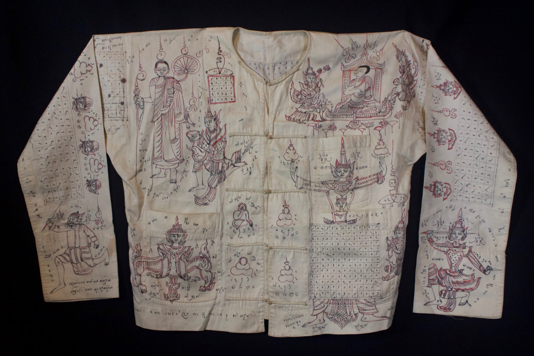 """Amulet Yantra Shirt - extremely rare and powerful protective garment Thailand Vietnamese tribal shaman Mid 20th c. Cotton, ink, pigment Handmade and drawn by the shaman, it depicts prayers, signs, numbers and a deities. The sacred cloth is an undergarment worn as a talisman with great protective power against physical harm, like bullets, spears, knives, wild animals and evil spirits. This one may have been commissioned by a wealthy man who felt he needed protection. Soldiers would also wear these if they could afford one. 21"""" x 61"""" $2900"""
