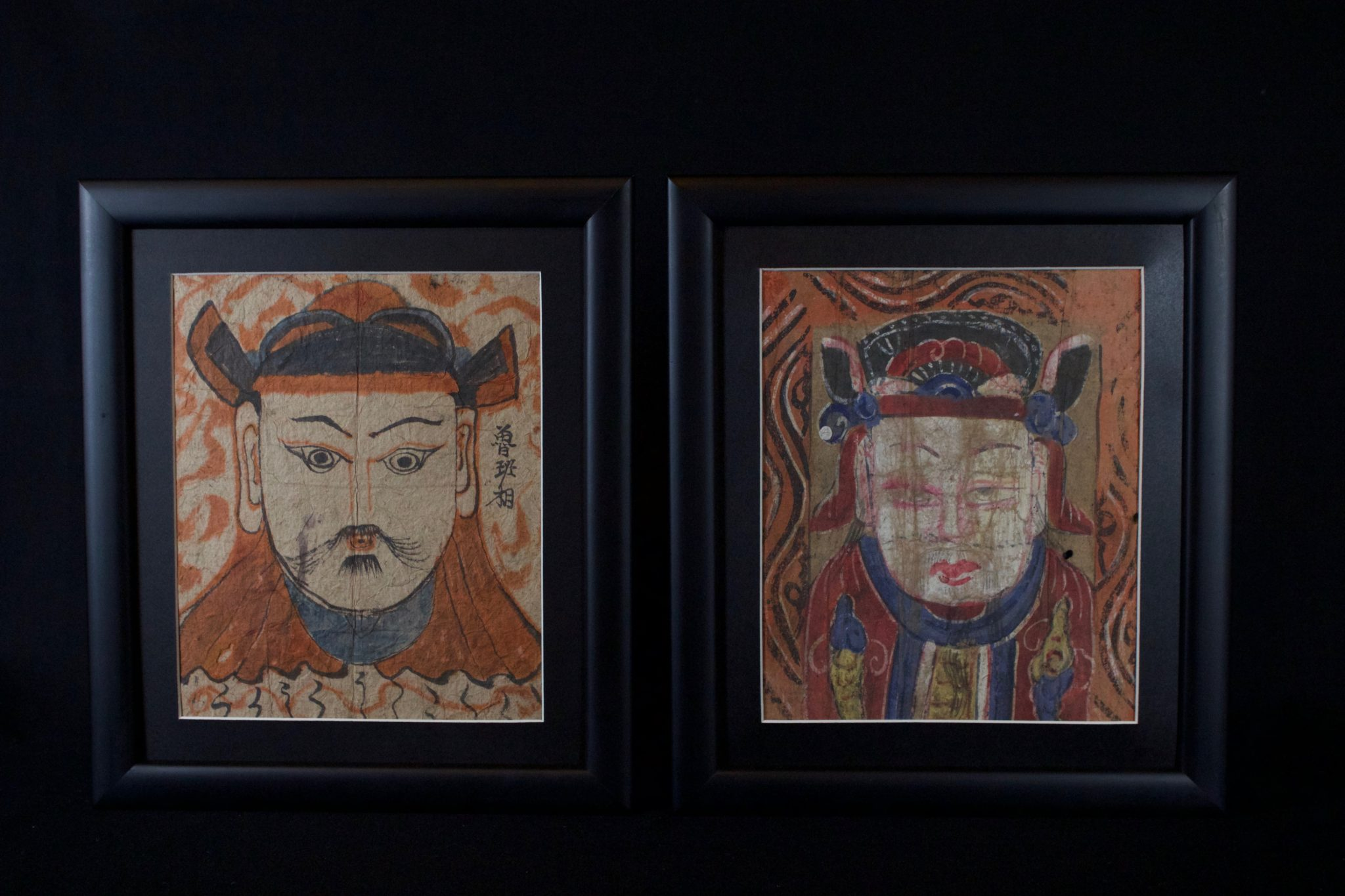 """Ceremonial Mask Vietnam/Thailand Early 20th c. Pigment (ink and watercolor) on handmade paper Paper masks are required possessions for shaman. Usually tied to the forehead, they are worn during certain rituals to impersonate deities. A shaman will have a full set of twenty seven. Only female shaman can wear masks of female deities. 11 ¼"""" x 9 ¾"""" x ¾"""" (framed) $240 each"""
