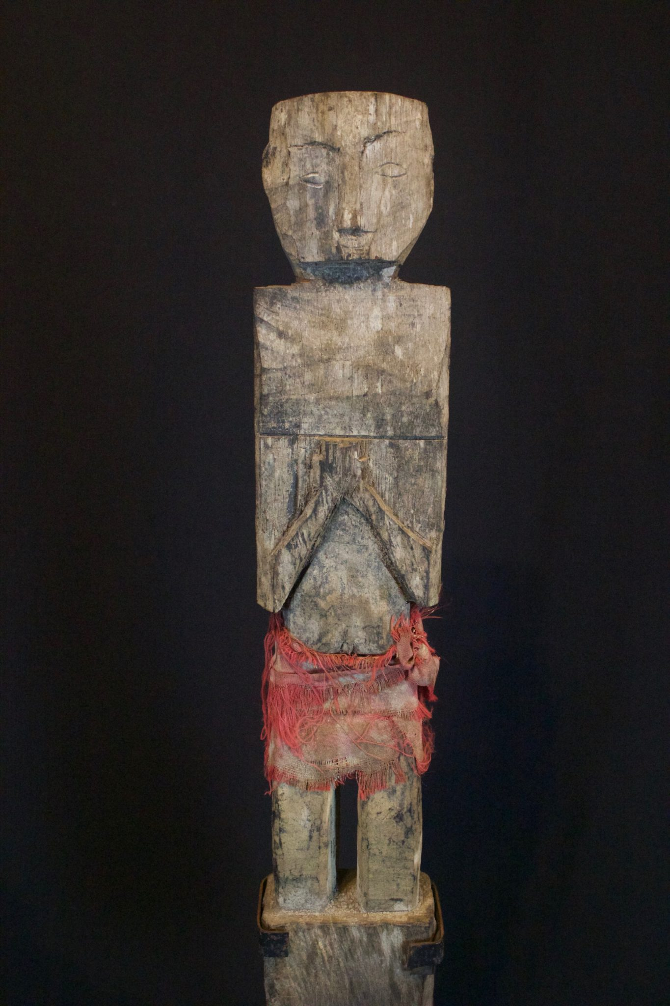 """Shaman Figure with Red Skirt, Kalimantan, Borneo, Indonesia, Dayak, Early 20th c, Wood, cotton cloth. Used for healing and protection. 20"""" x 4"""" x 2"""", $800."""