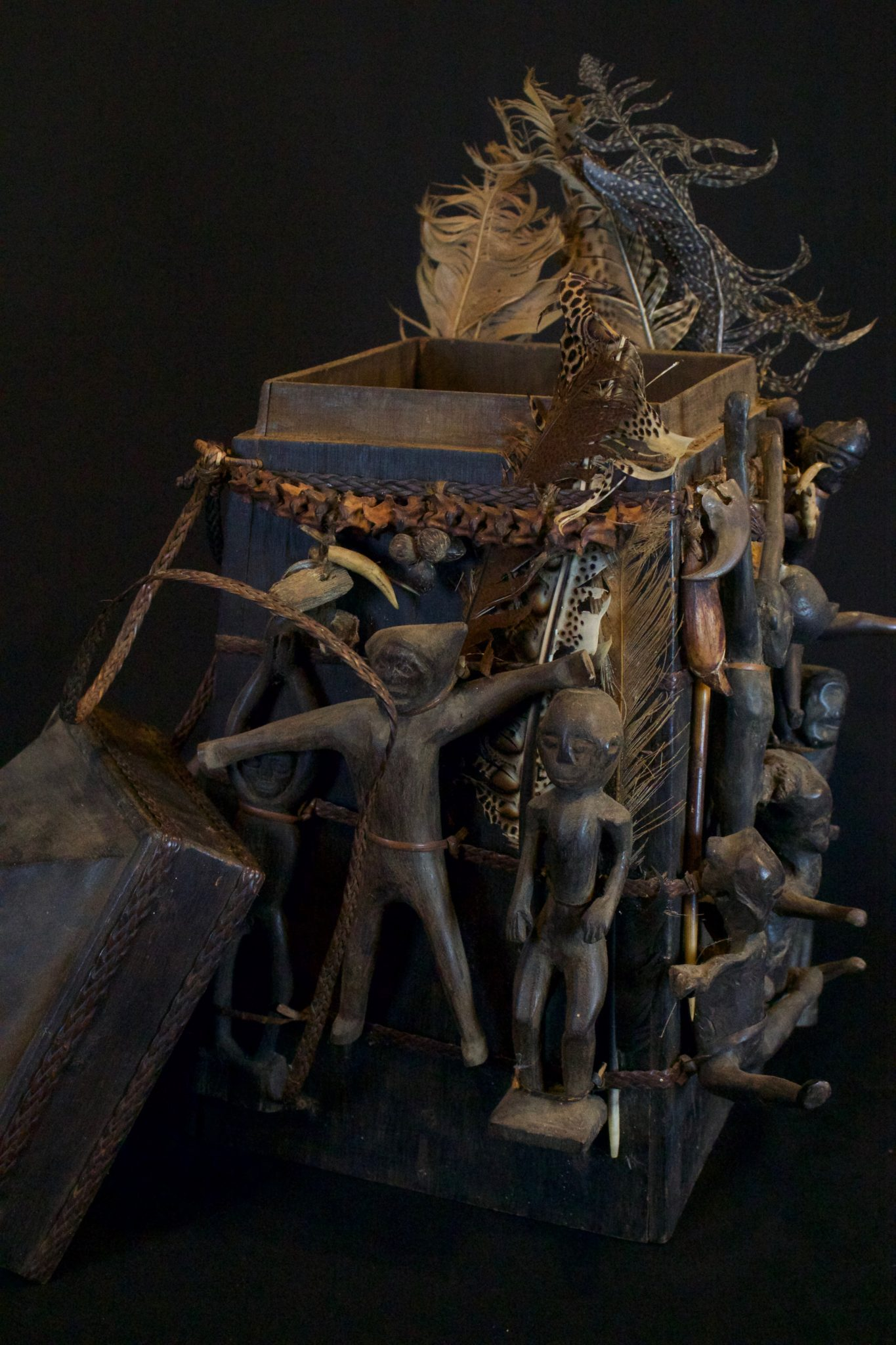 """'Lupong Manang' Shaman's Medicine Carrier/Backpack with Healing Charm Figures (rare), East Kalimantan, Borneo, Indonesia, Dayak tribe. Late 19th to early 20th c, Wood, braided reed, feathers. The Shaman made his own medicine kit to contain items for healing, protections and predictions – such as special teeth, stones and other items. The figures on the exterior correspond to illnesses and other conditions or ailments. 17 ½"""" x 13"""" x 13"""", $4800."""