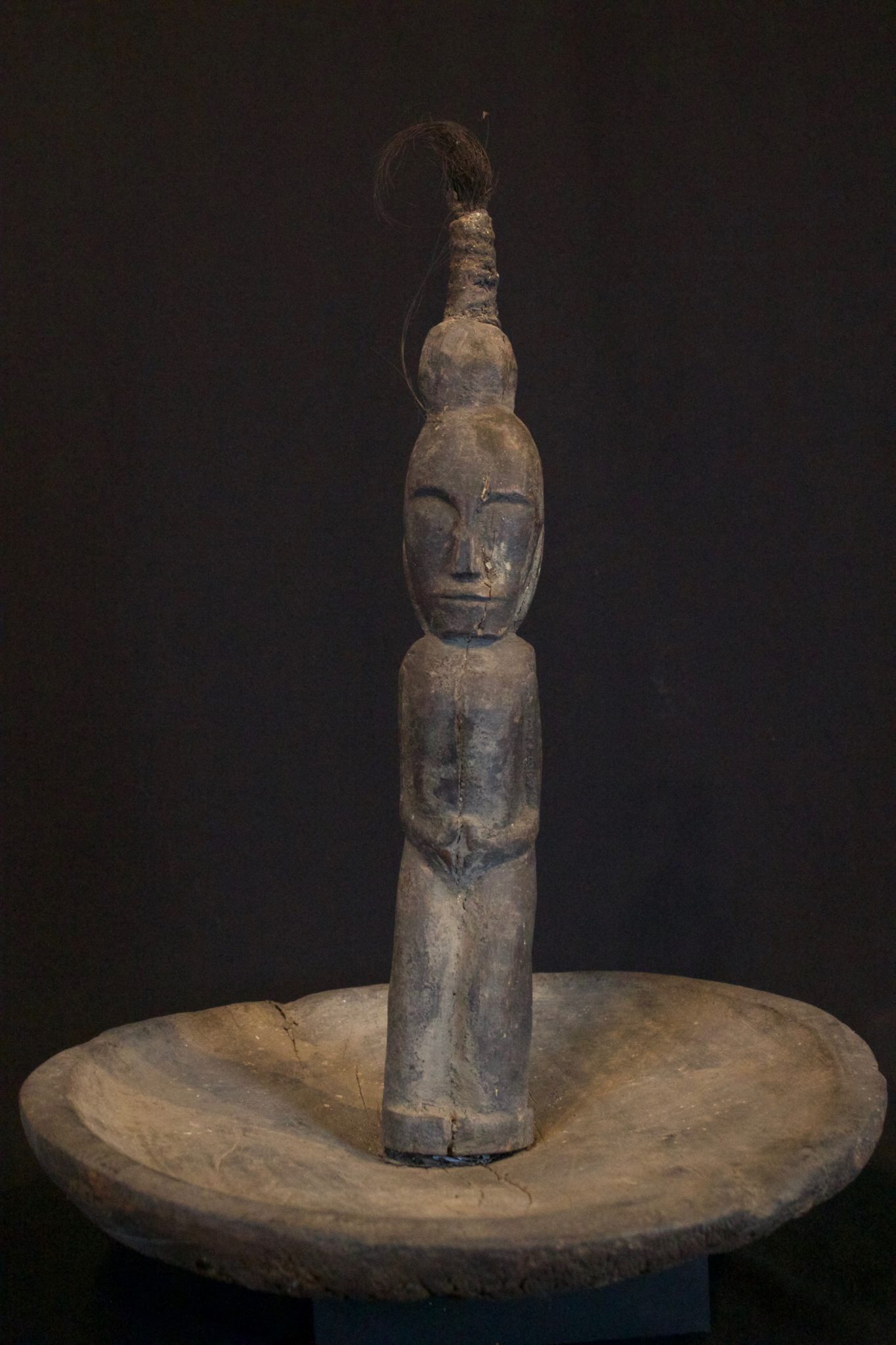 """Shaman Figure andOffering Platter, Sumatra, Indonesia, Batak tribe, Late 19th c, Wood, animal hair. For making offerings to spirits and deities. 18 ½' x 14"""" x 14"""", $650."""