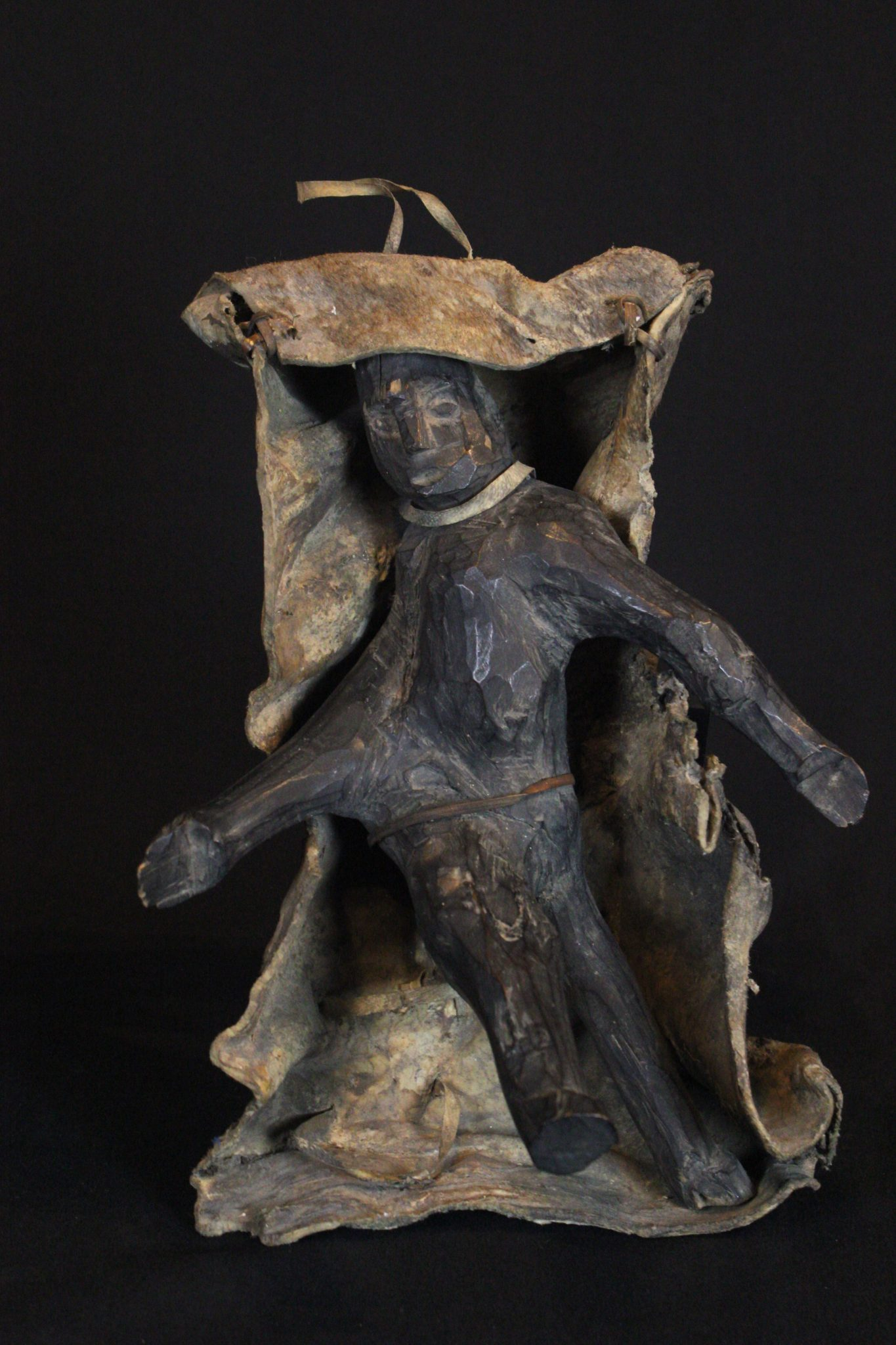 """Shaman Fetish Figure, Kalimantan, Borneo, Indonesia, Dayak tribe Early 20th c, Wood pigmented with soot, animal hide. Hung on the wall in the shaman's house and used for calling spirits and for healing rituals. 12"""" x 8"""" x 6"""", $600."""