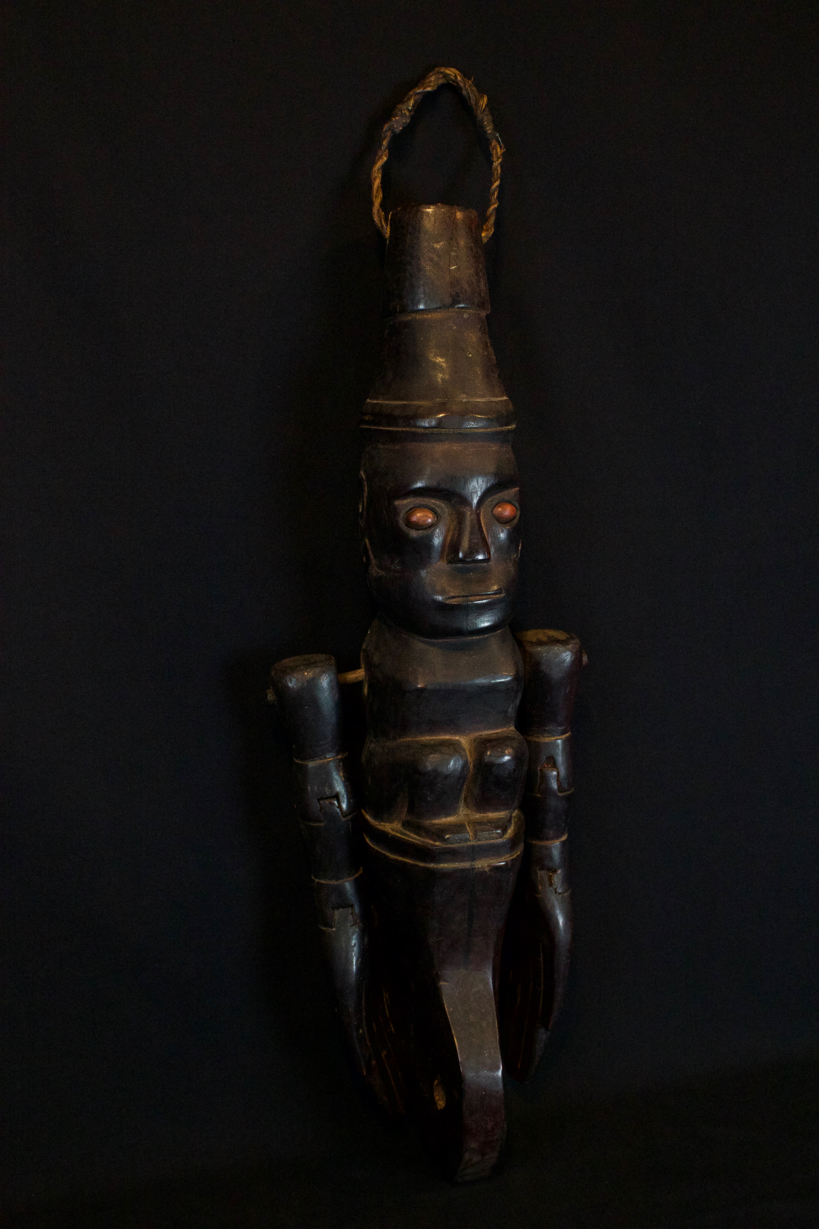 """Shaman Divining Effigy, Sumatra, Indonesia, Karo village, Batak tribe, Late 19th c, Wood, pigment, fiber cord, smooth patina from use and age. Used to predict the future. 20"""" x 9"""" x 6"""", $1450."""