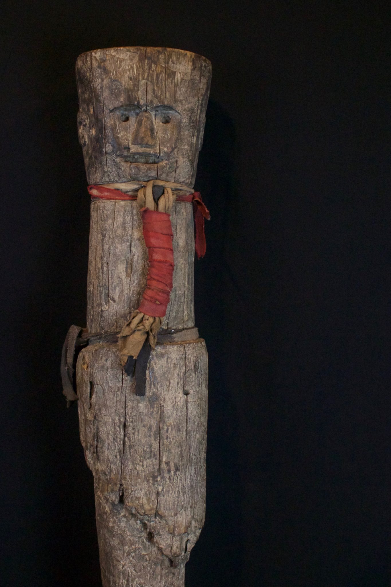 """Shaman Protector Figure, Kalimantan, Borneo, Indonesia, Dayak tribe, Early 20th c, Wood, cloth straps. Kept in the shaman's home for his protection. 28"""" x 6"""" x 5 ½"""", $1900."""