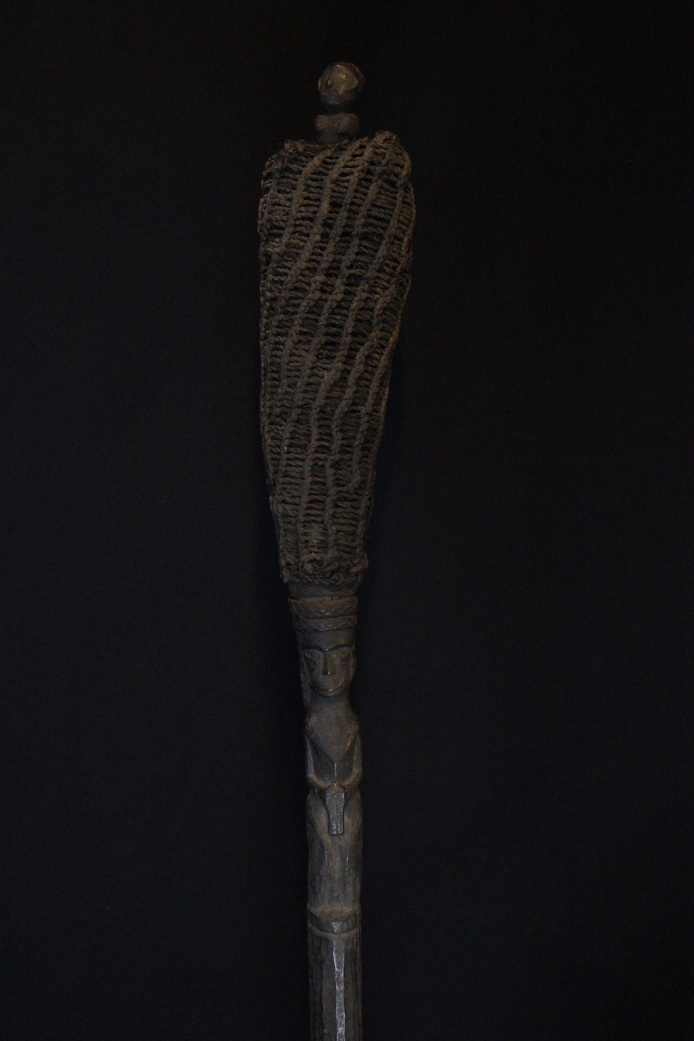 """Shaman's Magic Staff, Sumatra, Indonesia, Batak tribe, Early 20th c, Wood, plant fiber, rattan, pigmented with soot. Used for calling spirits and in healing rituals. 56 ½"""" x 5"""" x 4 ¾"""", $1600."""