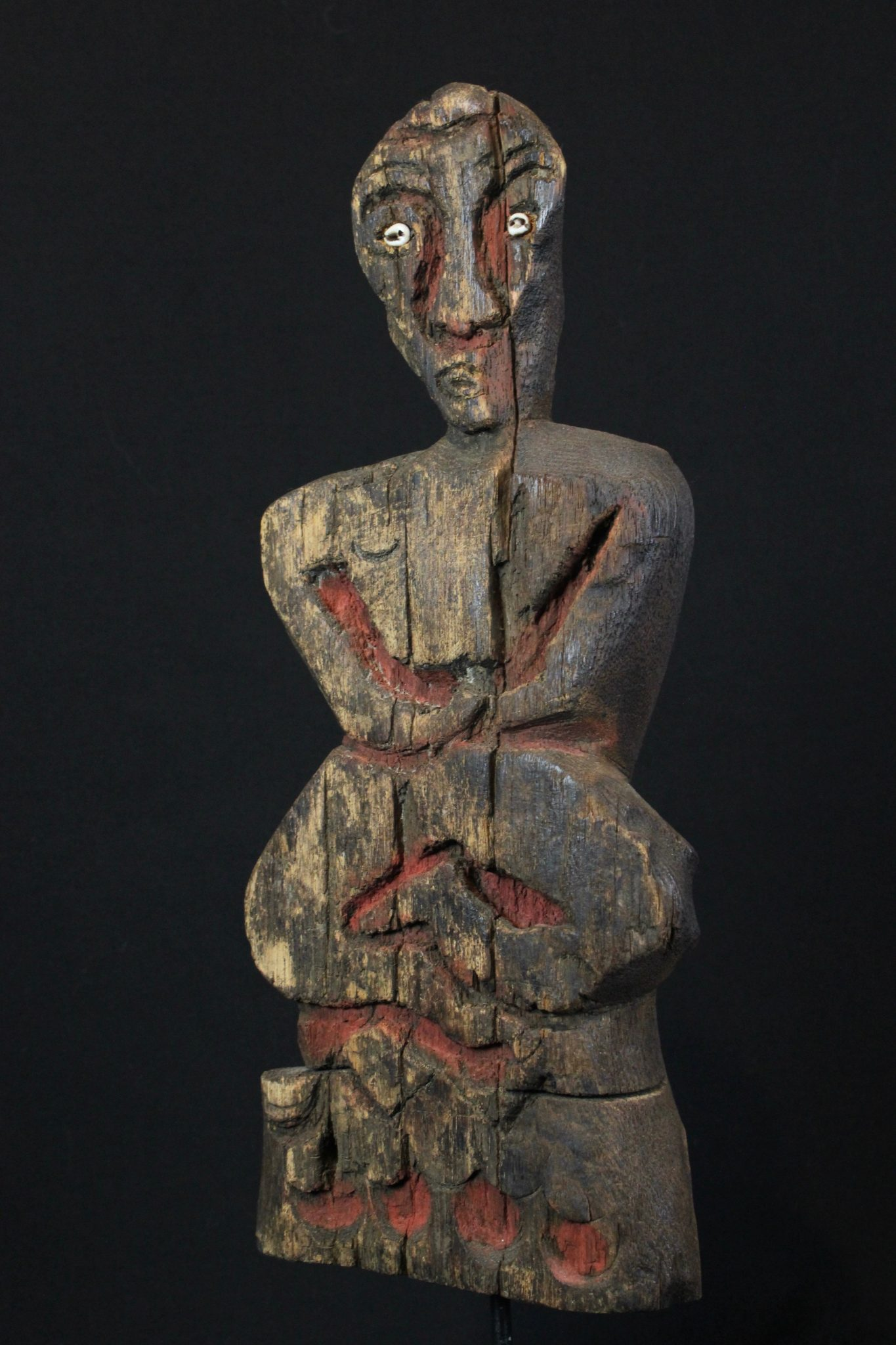 """Shaman Effigy Figure, Nagaland, India, Naga tribe, Early 20th c, Wood, pigment, shell, Probably for calling spirits as well as for use in healing rituals There are 7 images on the back of creatures made by poking holes as an outline for each one. 14"""" x 5 ¾"""" x 2 ¾"""", Sold"""