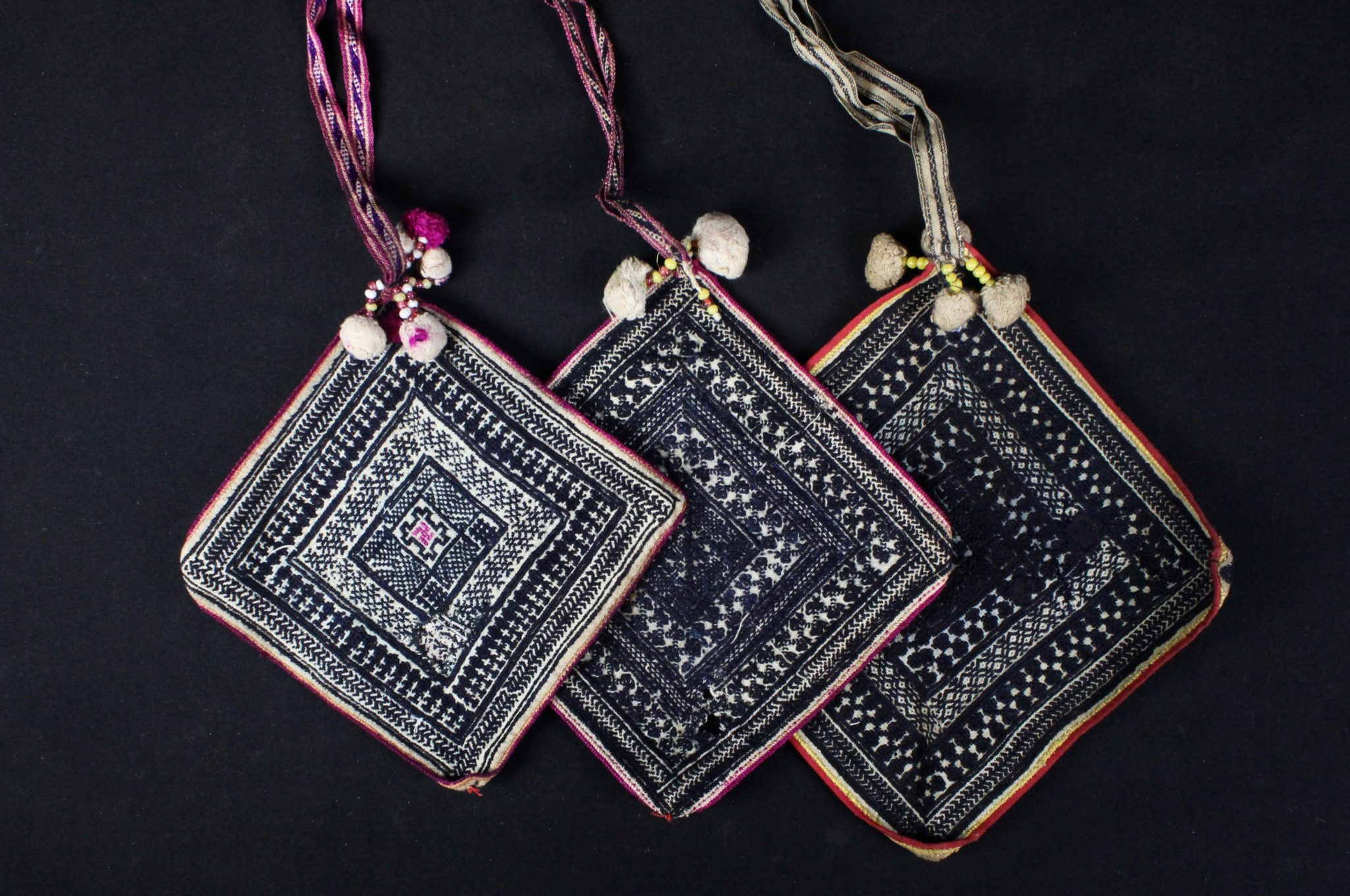 Handkerchief/Panel from a Shamanic Belt, Da Bac district, Hoa Binh province, Vietnam, Tight Trouser Dao people Early to mid 20th c, Cotton, hand embroidered with silk, Worn by shaman while performing religious rituals. A complete belt would have a minimum of 12 squares (handkerchiefs). The belt is passed down through generations, revealing its history. If a shaman has two sons or apprentices, he will spit the belt and the new shaman's wife will make the other necessary handkerchiefs. $75. to $90.