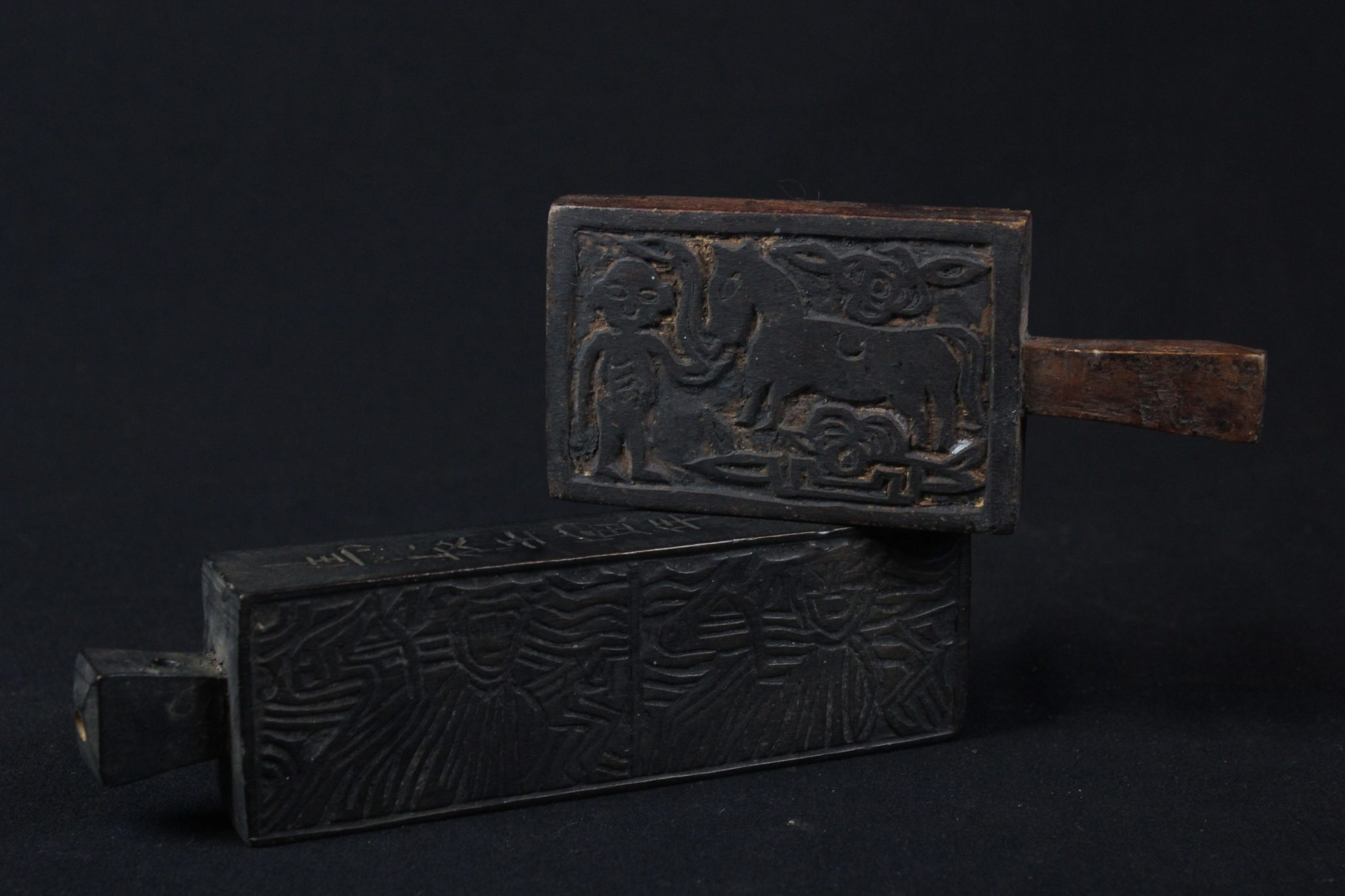 """Shaman Printing Block, Tuyen Quang province, Vietnam, Mid 20th c, Printing blocks are important shaman tools for creating talismans and ghost money to burn as offerings to deities. They were stamped on paper or on envelopes to mark the contents as holy. (Top - 2 ¼"""" x ½' x 5', $110.); (Bottom, 1 ¾"""" x 6 ¼"""" x 1"""", $90.)"""