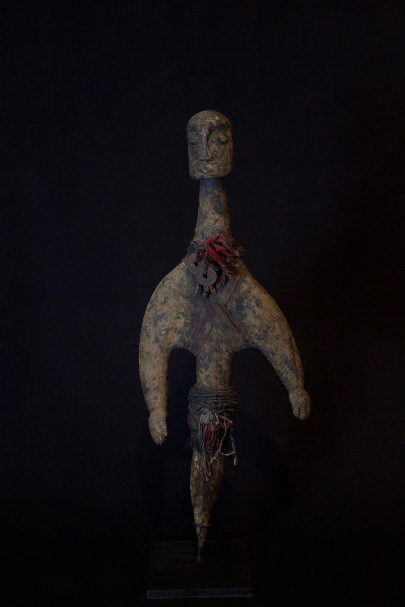 """Shaman Protection Figure, Indonesia, Lombok Island, Early 20th c, Wood, cloth, coins, beads. Protects shaman and client from harmful spirits during rituals, 20"""" x 7 ½"""" x 3 ½"""", $1100."""