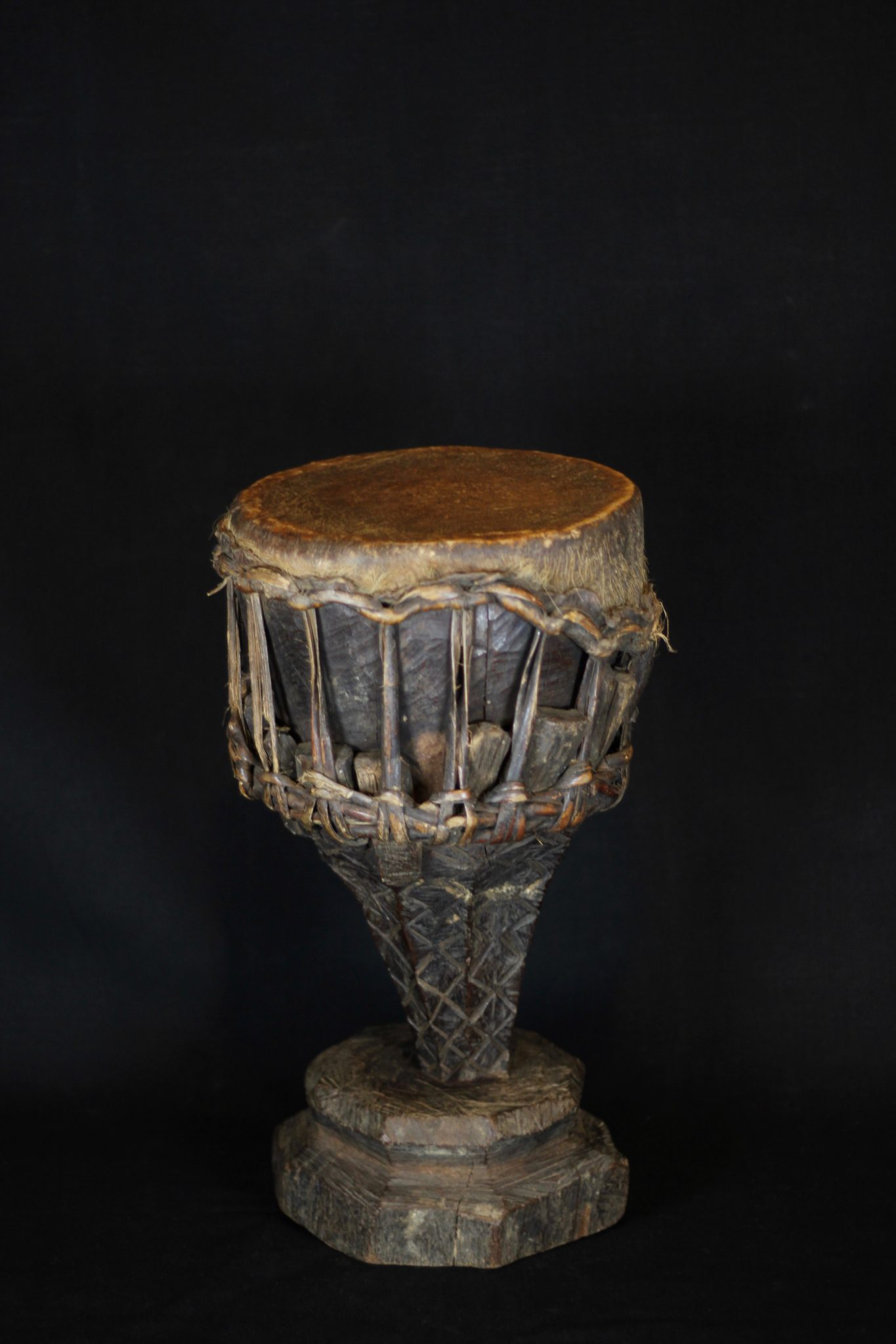 """Shaman Drum, Sumba Island, Indonesia, Early to mid 20th c, Animal skin stretched over wood, Used by shaman to initiate and maintain a trance state during rituals, 17 ½"""" x 10 ½' x 10"""", $490."""