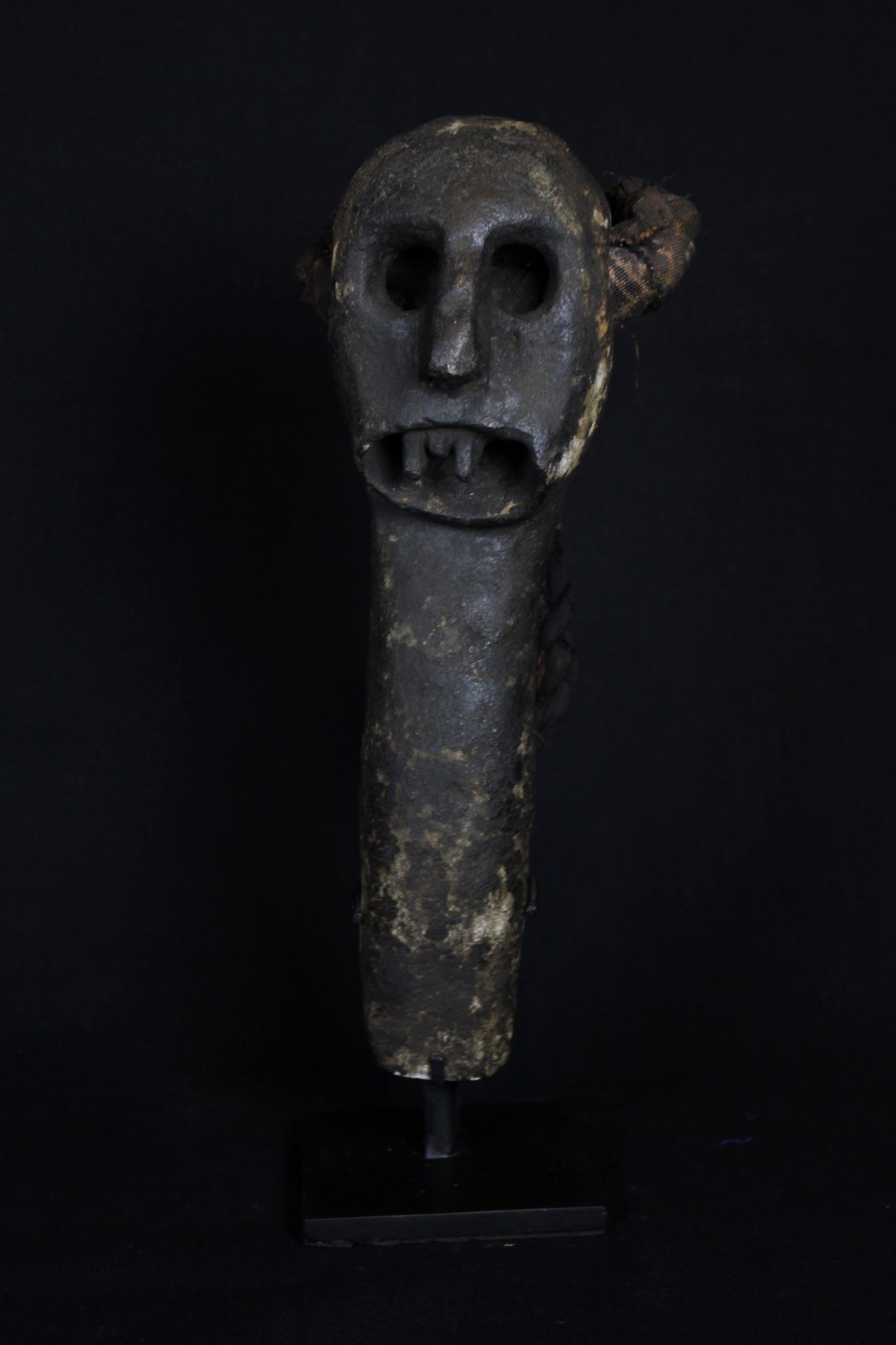 """Nitta Watu (rare), Kitchen Protector Figure - Shaman Power Object, West Flores Island, Lesser Sunda Islands, Indonesia, Maumere district, Nita or Bena Village, Early to mid 19th c, Stone, pigment, cloth strap for hanging. Used to protect a house or home. 14"""" x 5 ½"""" x 6"""", $1700."""