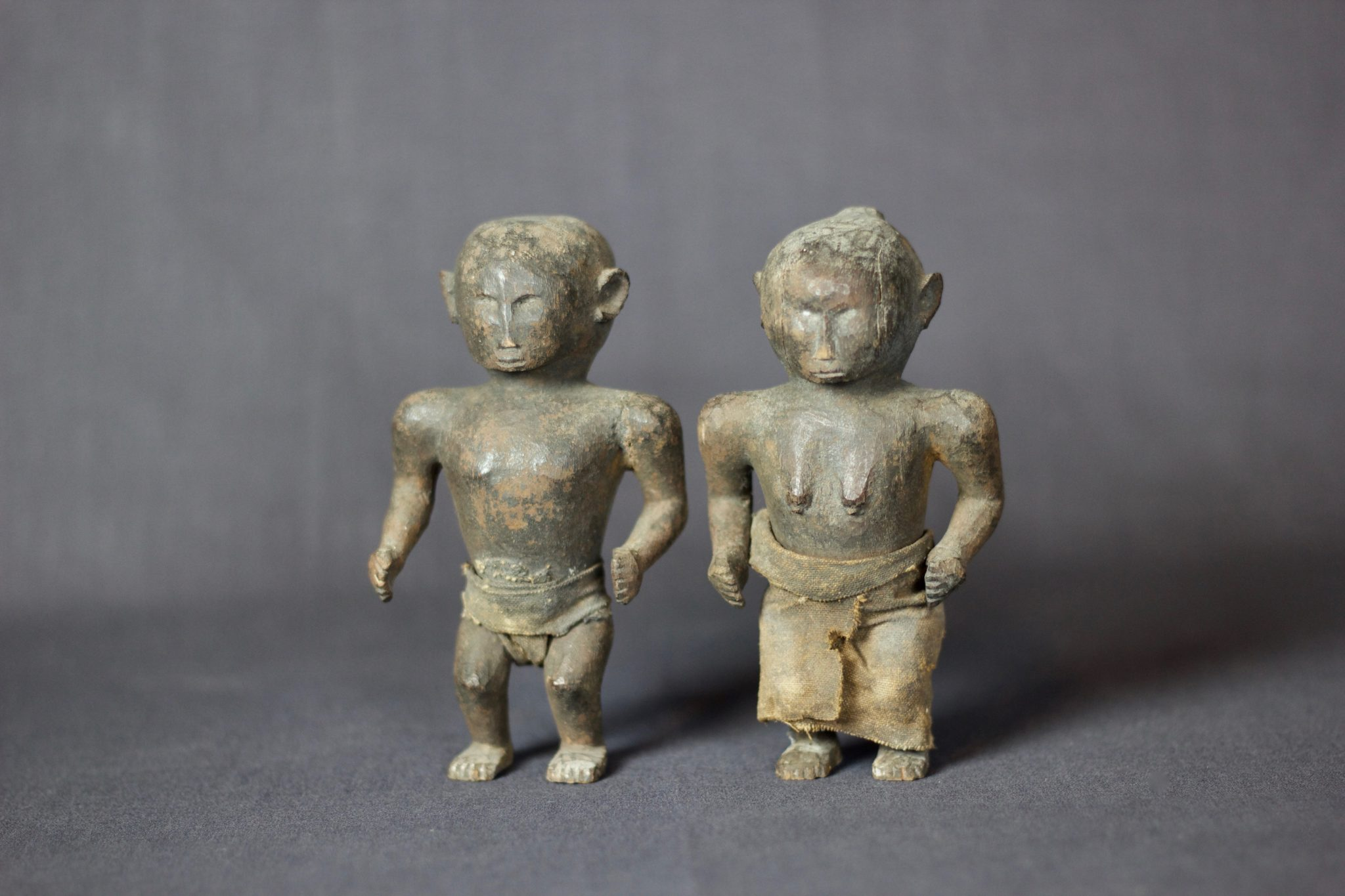 """Shaman Healing Couple Effigy, West Sumba Island, Lesser Sunda Islands, Indonesia, Anakalang village Early to mid 20th c, Wood, fiber cloth, patinated with use and age, Used in healing rituals and to fix marriages. Dimensions: (left, male: 5 ¼"""" x 3 ¼"""" x 2""""); (right, female: 5"""" x 3"""" x 2""""), $420. sold as a pair"""