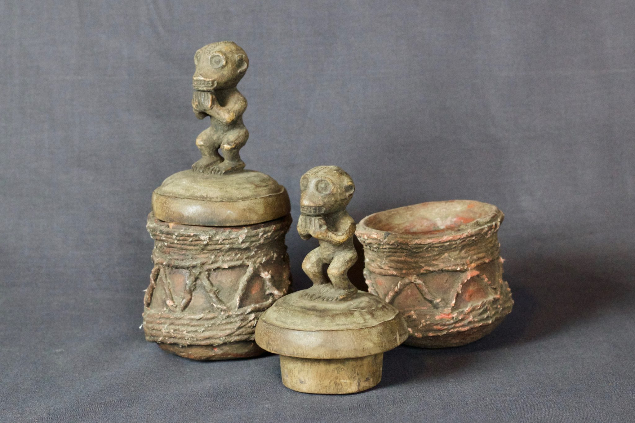 """Holy Water Containers, Lombok Island, Lesser Sunda Islands, Indonesia, Mid 20th c, Wood, ceramic, fiber, pigment. Shaman jar for holy water for purification rituals. Dimensions: (left - 6"""" x 3 ¼"""" x 3 ¼"""", Sold); (right - 6 ¼"""" x 3 ¼"""" x 3 ¼"""", sold)"""