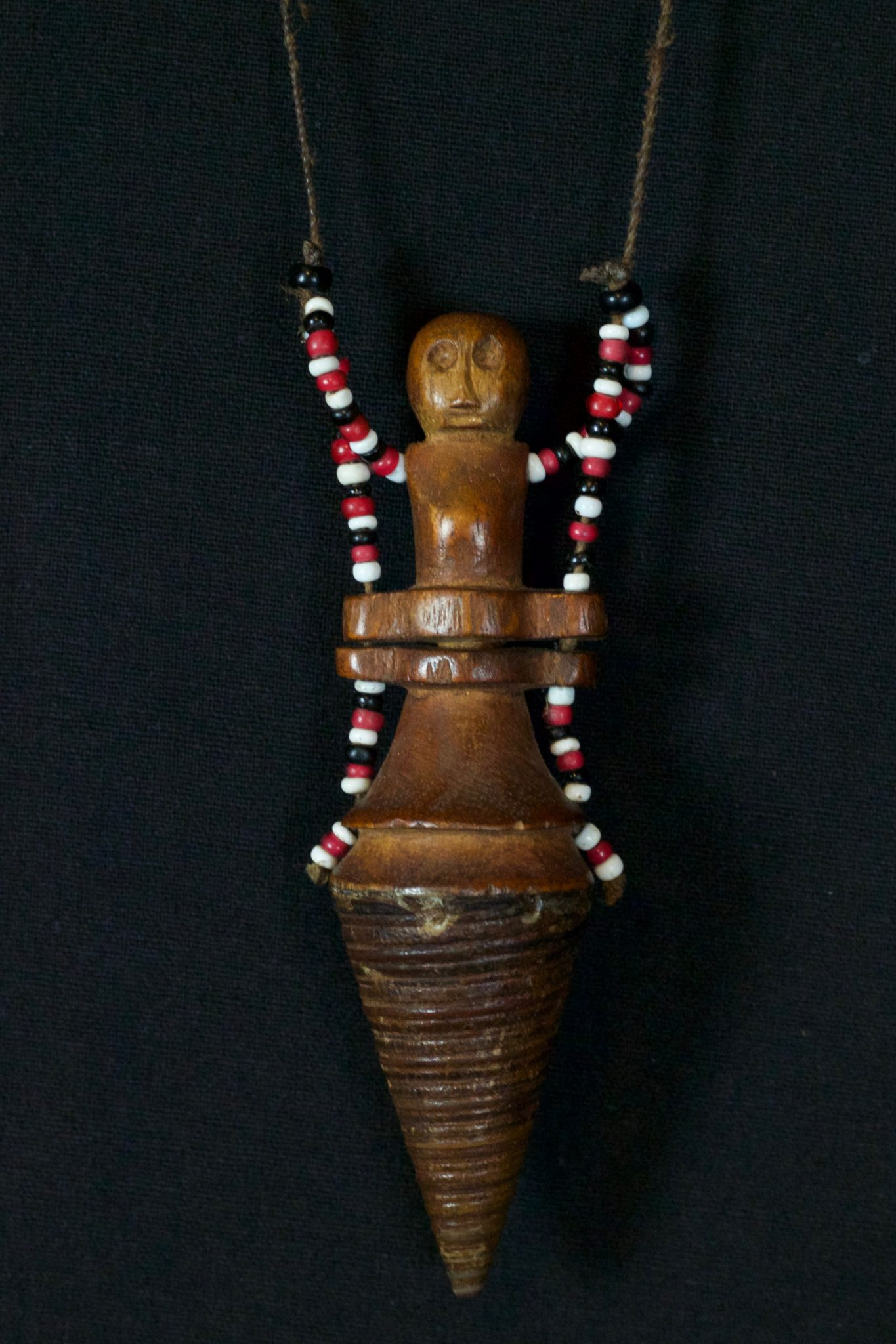 """Shaman Healing Medicine Container Necklace, Alor Island, Timor Islands, Lesser Sunda Islands, Indonesia, Mid 20th c, Wood, beads, shell (Telescopium telescopium, or Horn snail spire). Used to hold medicine for healing rituals, 4 ½"""" x 1 ½"""" x 1 ¼"""", $390."""