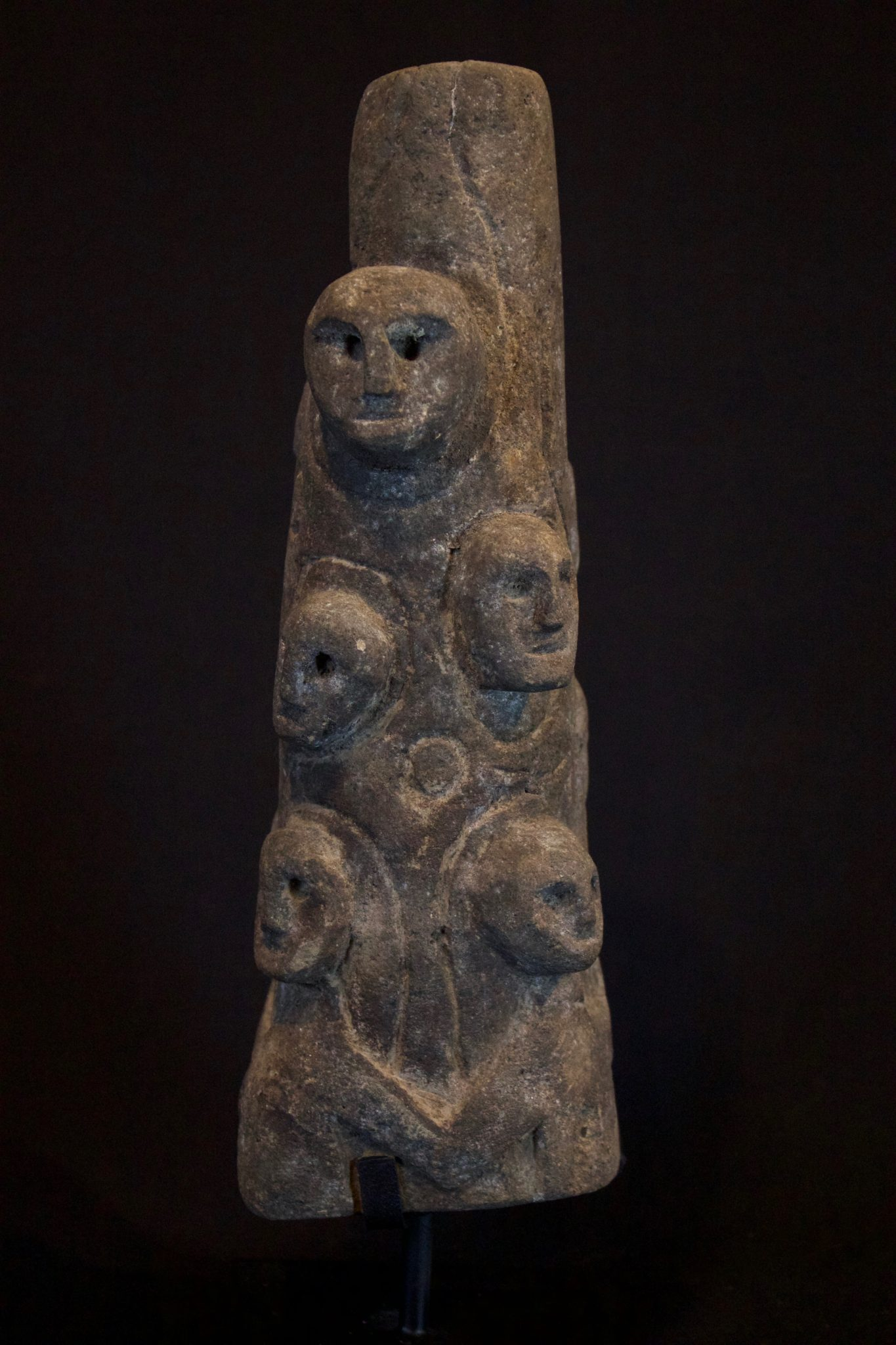 """Ancestral Offering Statue, Indonesia, Timor Island, Boti village, Mid 20th century Wood. This totem-like carving of many ancestor effigies is used by shamans in contacting spirits and healing rituals. 11 ½"""" x 4"""" x 3 ½"""", sold"""