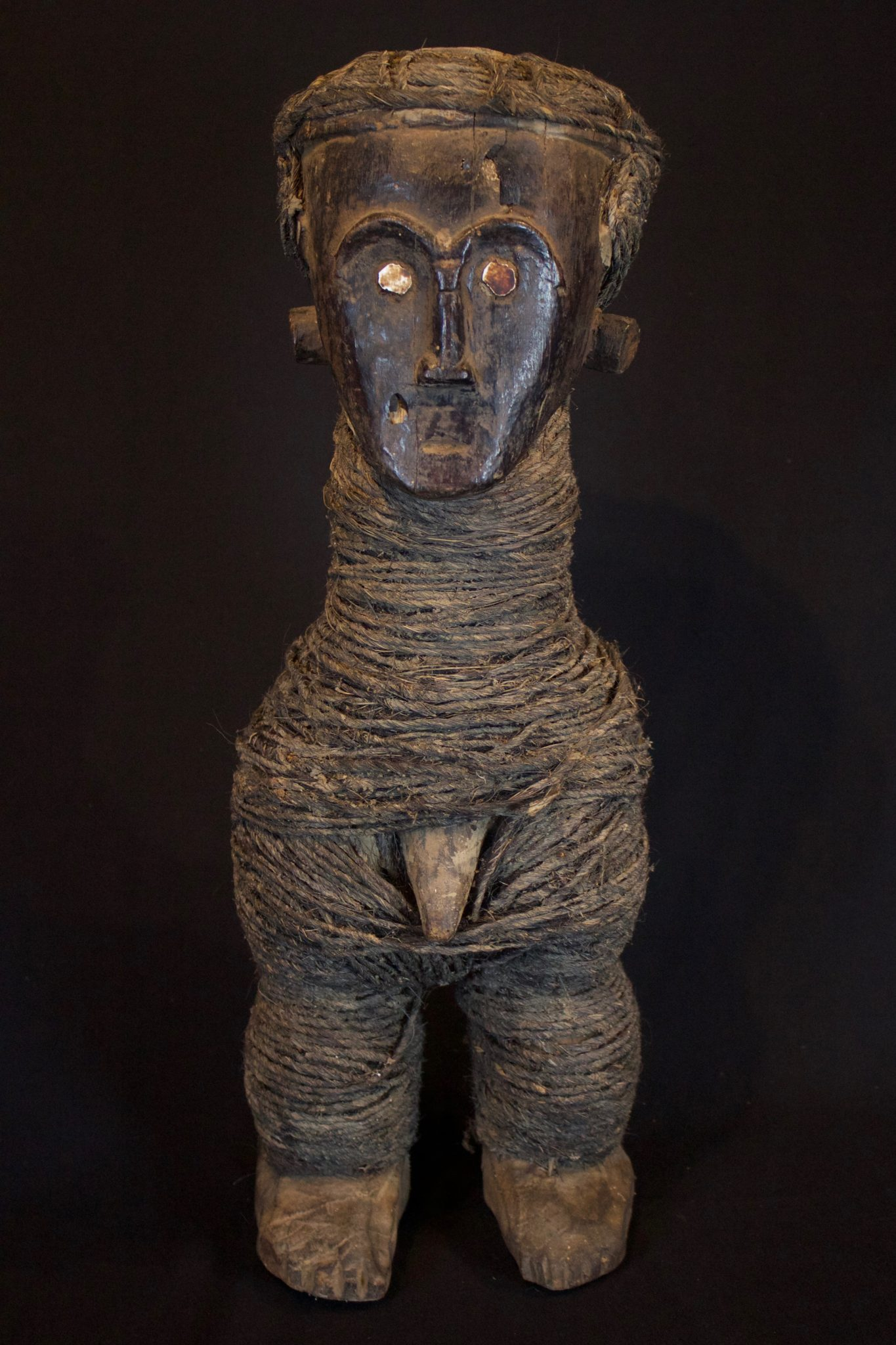 """Shaman's Ritual Figure, Timor Island, Sunda Island, Indonesia, Niki Niki village Early 20th c, Wood, fiber cord, shell. Used by shaman to treat people as well as for other traditional rituals. 21"""" x 7 ½"""" x 6 ½"""", $1400."""