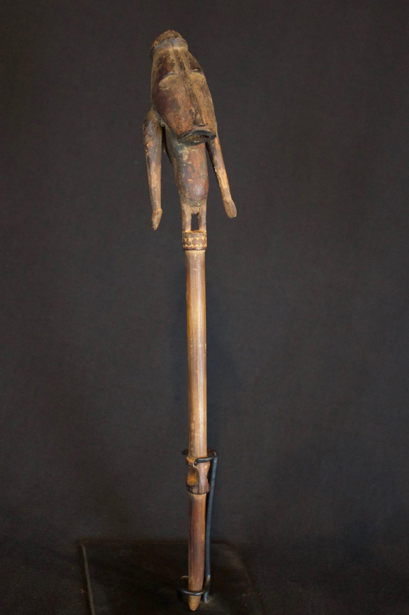 "Shaman Magic Figure, Papúa New Guinea, Indonesia, Early 20th c, Wood, fiber. Used in ritual ceremonies to stop rain. 11 ½"" x 1 ½"" x 1 ¼"", $135."