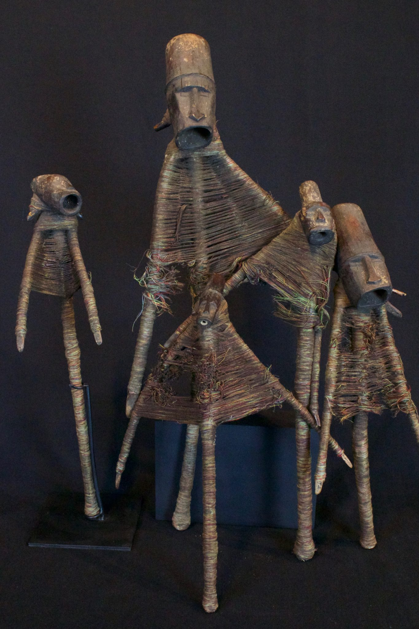"""Magic Protection Figures East Flores Island, Lesser Sunda Islands, Indonesia, Mid 20th c, Wood, bamboo, thread. Kept in household kitchen to protect the home. Dimensions: 10"""" to 17"""" tall; $135. to $225."""