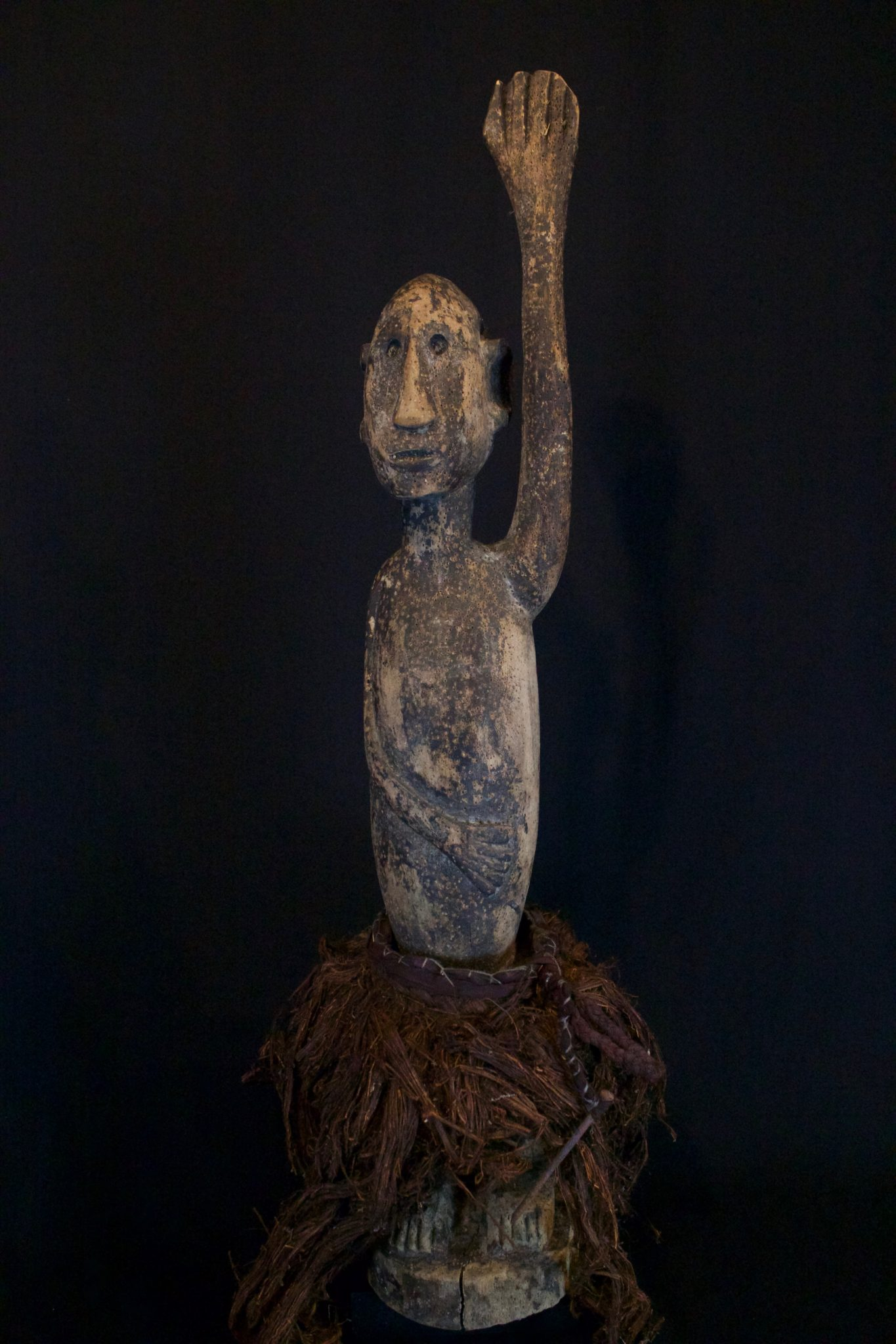 """Shaman Healing Fetish, Lesser Sunda Islands, Indonesia, Early 20th c, Wood, fiber, metal nail. Kept in the shaman's home. Covered in tiny holes from being pierced by its attached nail during rituals. Found in the ocean. 30"""" x 12"""" x 8"""", sold"""