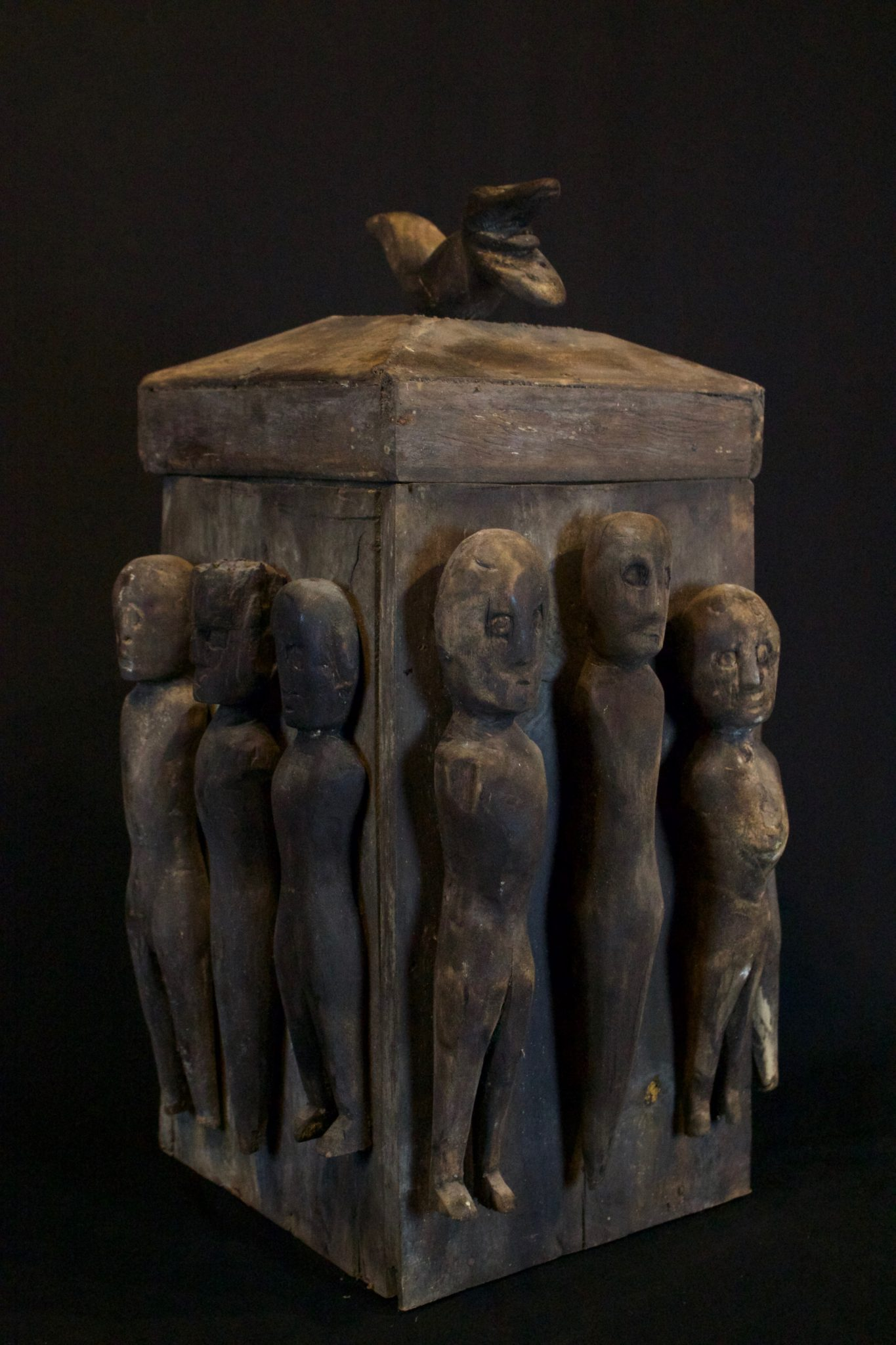 """'Lupong Manang' - Shaman's Medicine Carrier/Backpack with Healing Figures (rare), South Sulawesi, Indonesia, Toraja tribe, Mid 20th c, Wood, The Shaman made his own medicine kit to contain items for healing, protections and predictions – such as special teeth, stones and other items. The figures on the exterior correspond to illnesses and other conditions or ailments. 19"""" x 9 ½"""" x 10"""", $2200."""