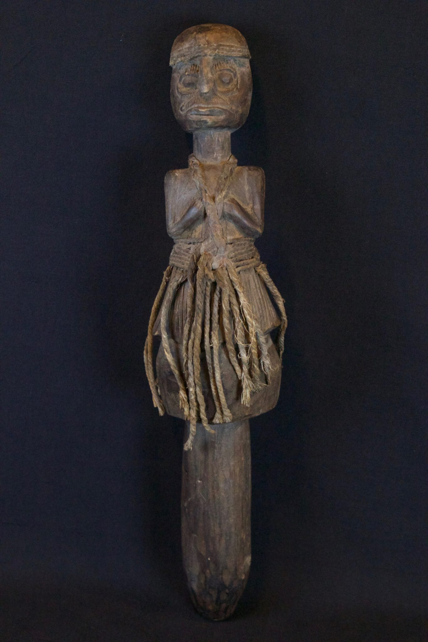 """Healing Fetish Wand, Lombok Island, Lesser Sunda Islands, Indonesia, Early 20th c, Wood, fiber, patinated from use and age. Held in shaman's hand during ritual for healing calling the spirits, 15 ½"""" x 3 ½"""" 4"""", $420."""