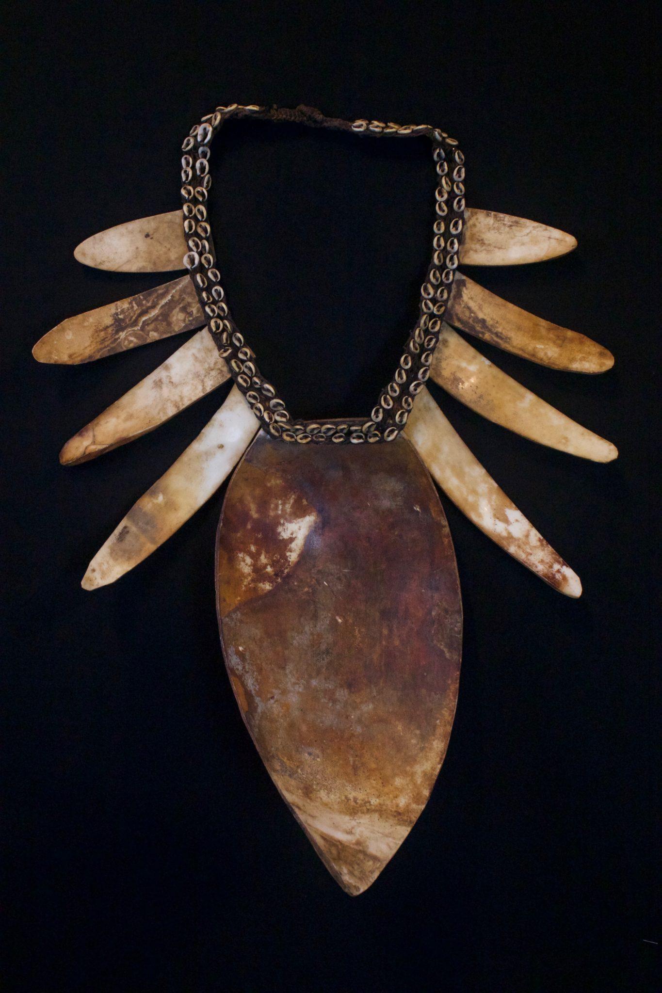 "Shaman Shell Necklace, Papua New Guinea (Irian Jaya), Indonesia, Mid 20th c. Shell, cloth, fiber cord. Worn by the shaman for healing ceremonies. 19"" x 15"" x 3 ½"" $850."