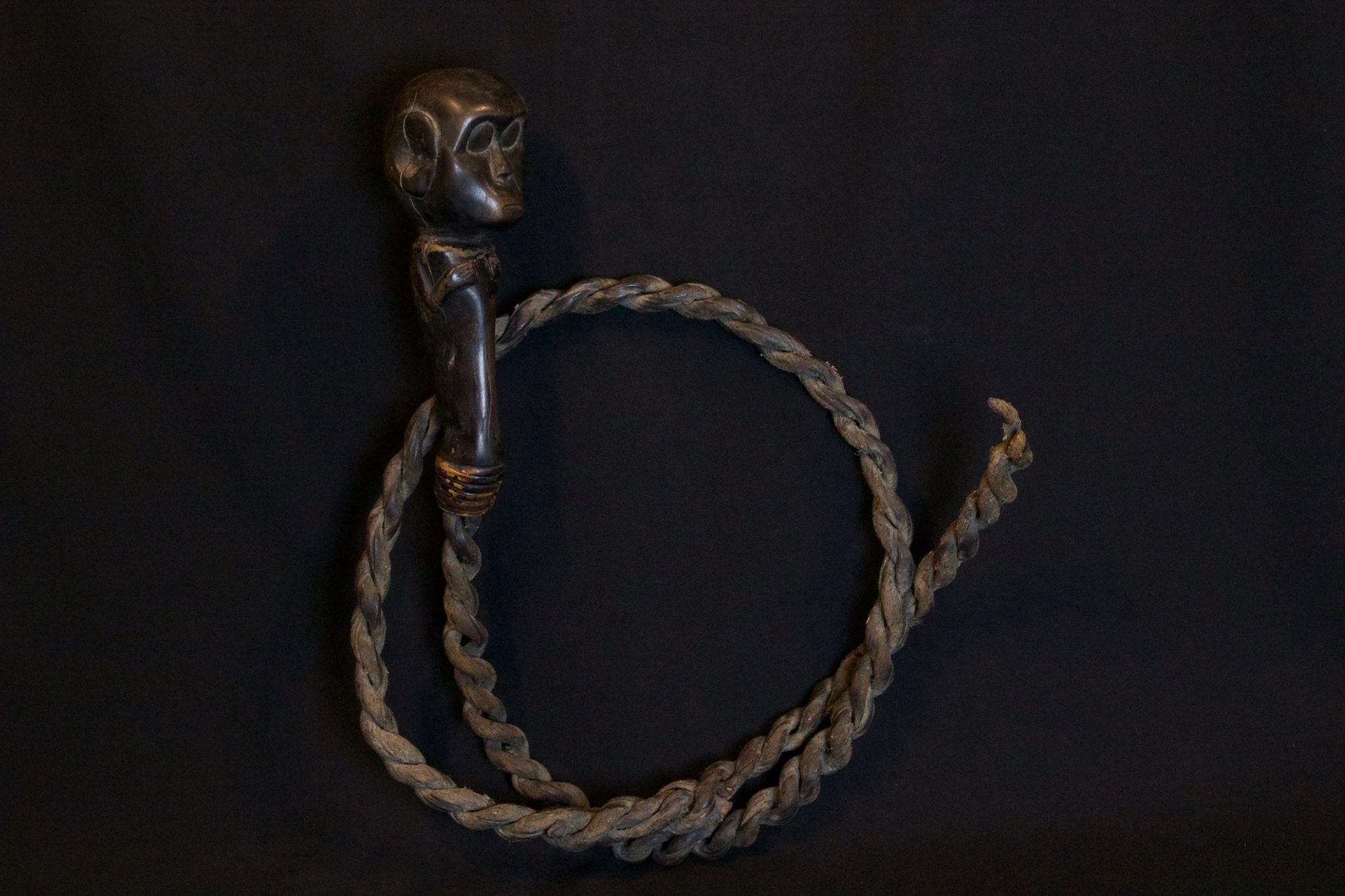 """'Caci', Ritual Fighting Whip - Caci Flores Island, Lesser Sunda Islands, Indonesia Manggarai tribe Early 20th c. Wood, rattan, bark, smooth patina from use and age Caci is a powerful magic whip-fighting ritual performed during a harvest festival with complex ritual preparations. It is played by 2 men, usually from different villages. The Whip symbolizes the male phallus, the father and the sky. The shield used with it symbolizes the female, the womb and the earth. These elements are united when the whip hits the shield symbolizing life giving sexual unity. It is a playful event but any blood shed is considered an offering to the ancestors who will then ensure fertility of the land. 14"""" x 10"""" x 2 ½"""" $520."""
