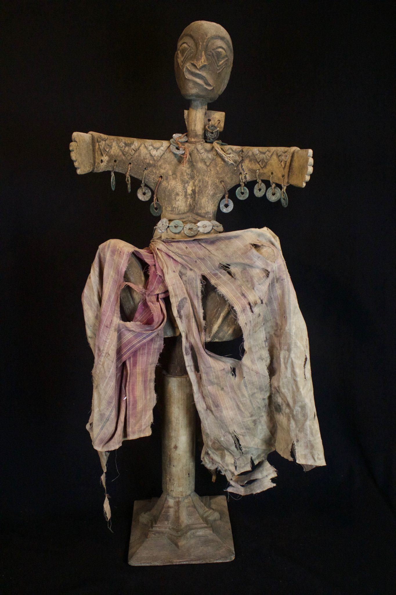"""Shaman Healing Fetish Wand Lombok Island, Lesser Sunda Islands, Indonesia, Late 19th c, Wood, cotton cloth, metal coins. This is held in the shaman's hand to contact the spirits for healing rituals. 35"""" x 13 ½"""" x 7 ½"""", $2400."""