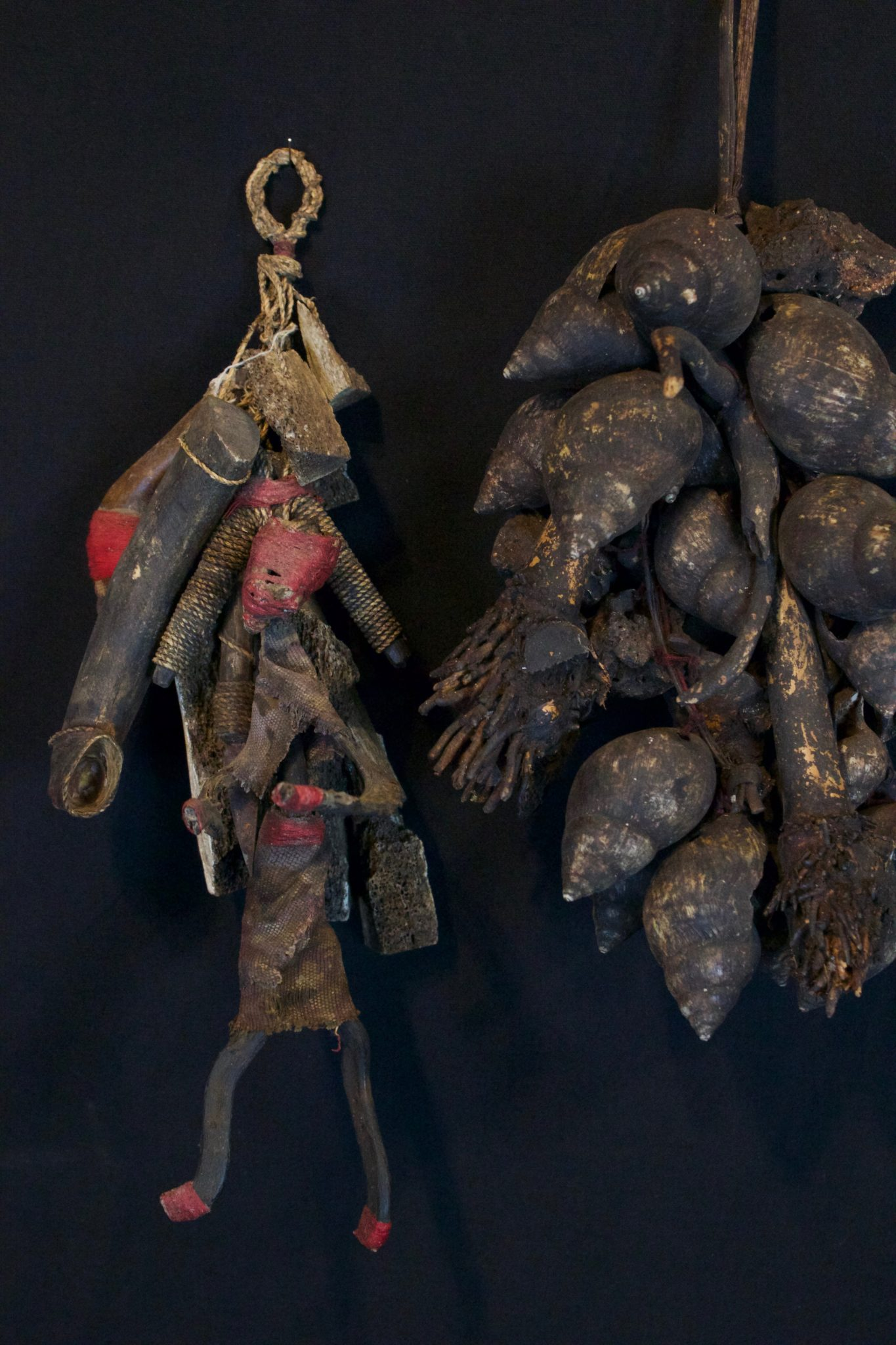 """Shaman Healing Fetish Rattles, Lombok, Lesser Sunda Islands, Indonesia, Early to mid 20th c, Wood pigmented with soot, metal blade, cloth fiber, patinated with age and use. Used for healing rituals - Shaken to fend off harmful spirits. Dimensions: (left - 12"""" x 5 ½"""" x 4"""", sold); (right - 14"""" x 7"""" x 6"""", Sold)"""
