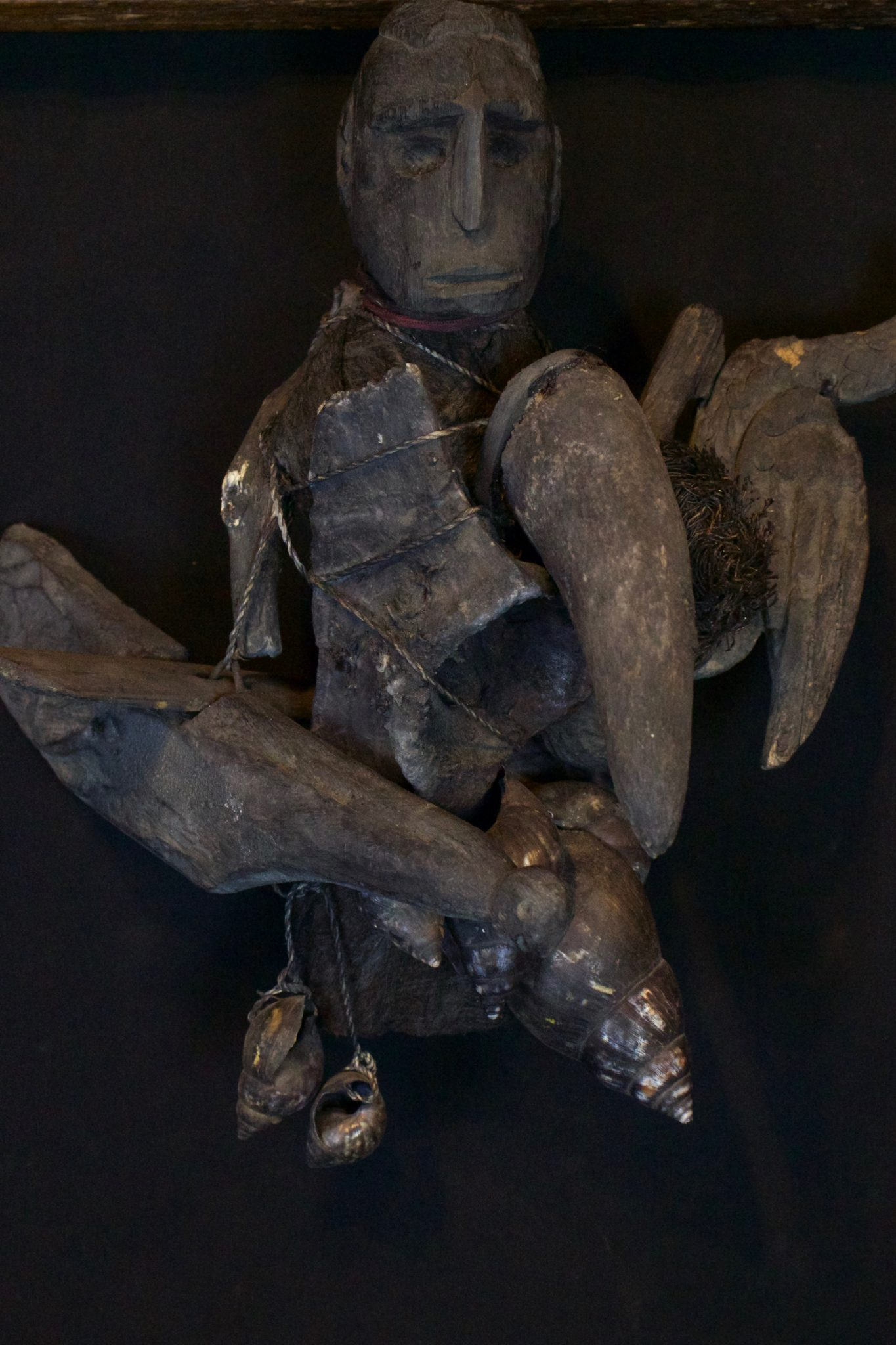 """Shaman Healing Fetish Rattle, Lombok Island, Lesser Sunda Islands, Indonesia, Mid to late 20th c, Wood pigmented with soot, bone, cloth, seed pod and shells, patinated with age and use. Used in healing rituals. 12"""" x 12"""" x 12"""", $1300."""