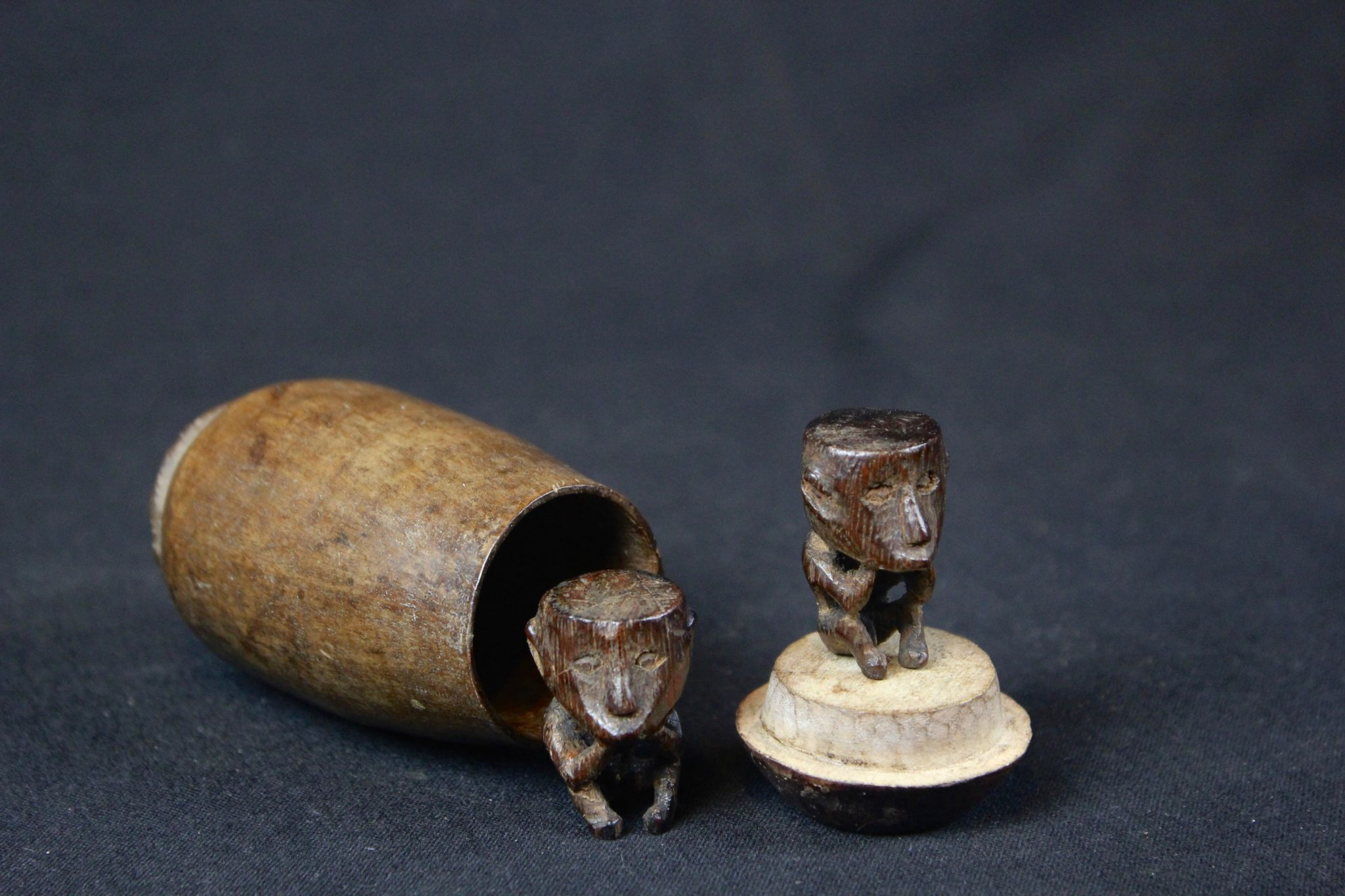 """Shaman Charms, West Sumba Island, Lesser Sunda Islands, Indonesia, Lamboya village, Early 20th c, Wood, smooth patina from use and age. Healing amulets. 3 ½"""" x 2"""" x 2"""" (container); 1 ¼"""" x ¾' x ½"""" (each figure), $375."""