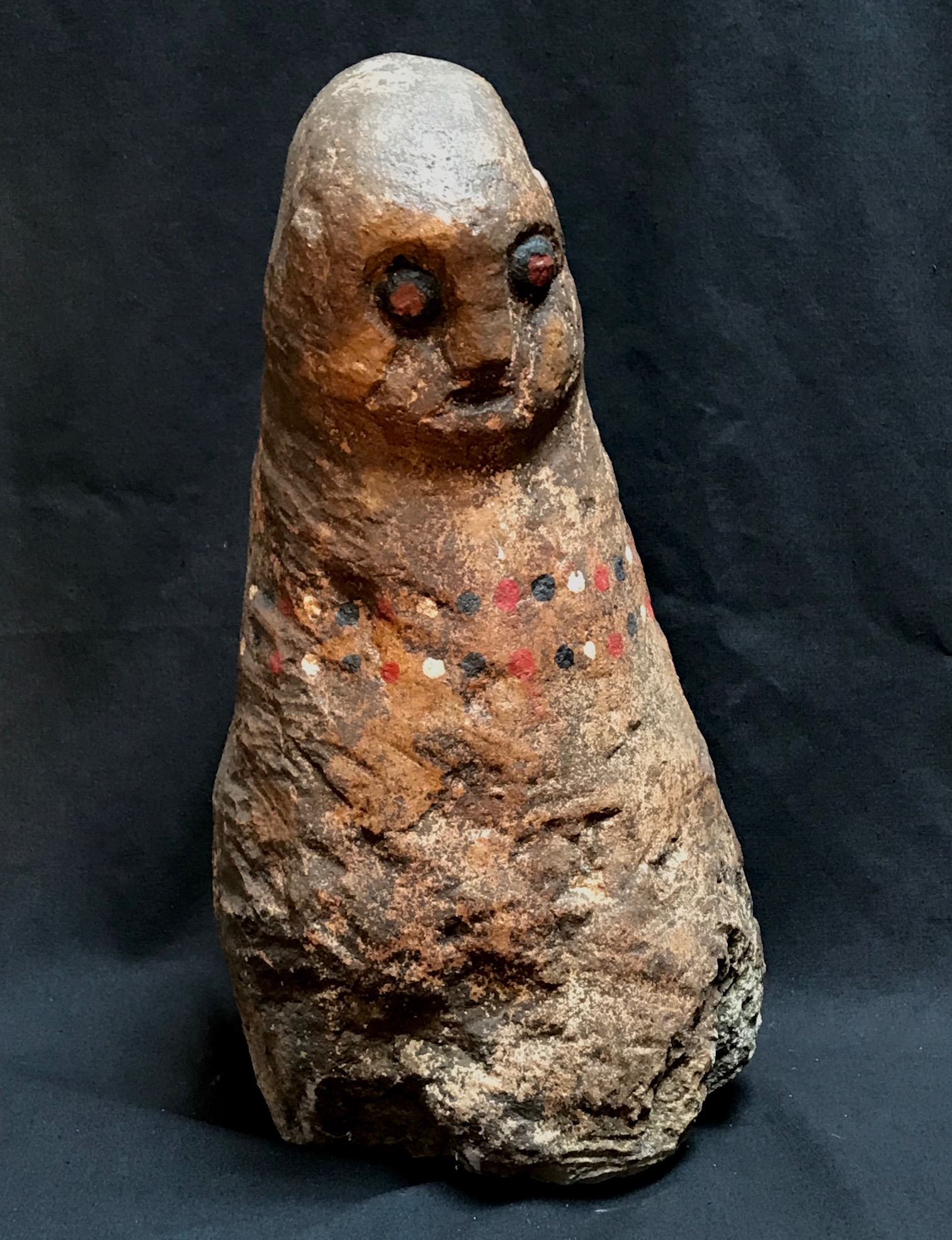 """Shaman Figure, Anakalang village, West Sumba Island, Indonesia, used for healing and protection and to predict auspicious dates for rituals, and possibly to find lost items. Early 20th c., stone, pigment, 15 1/4"""" x 8"""","""