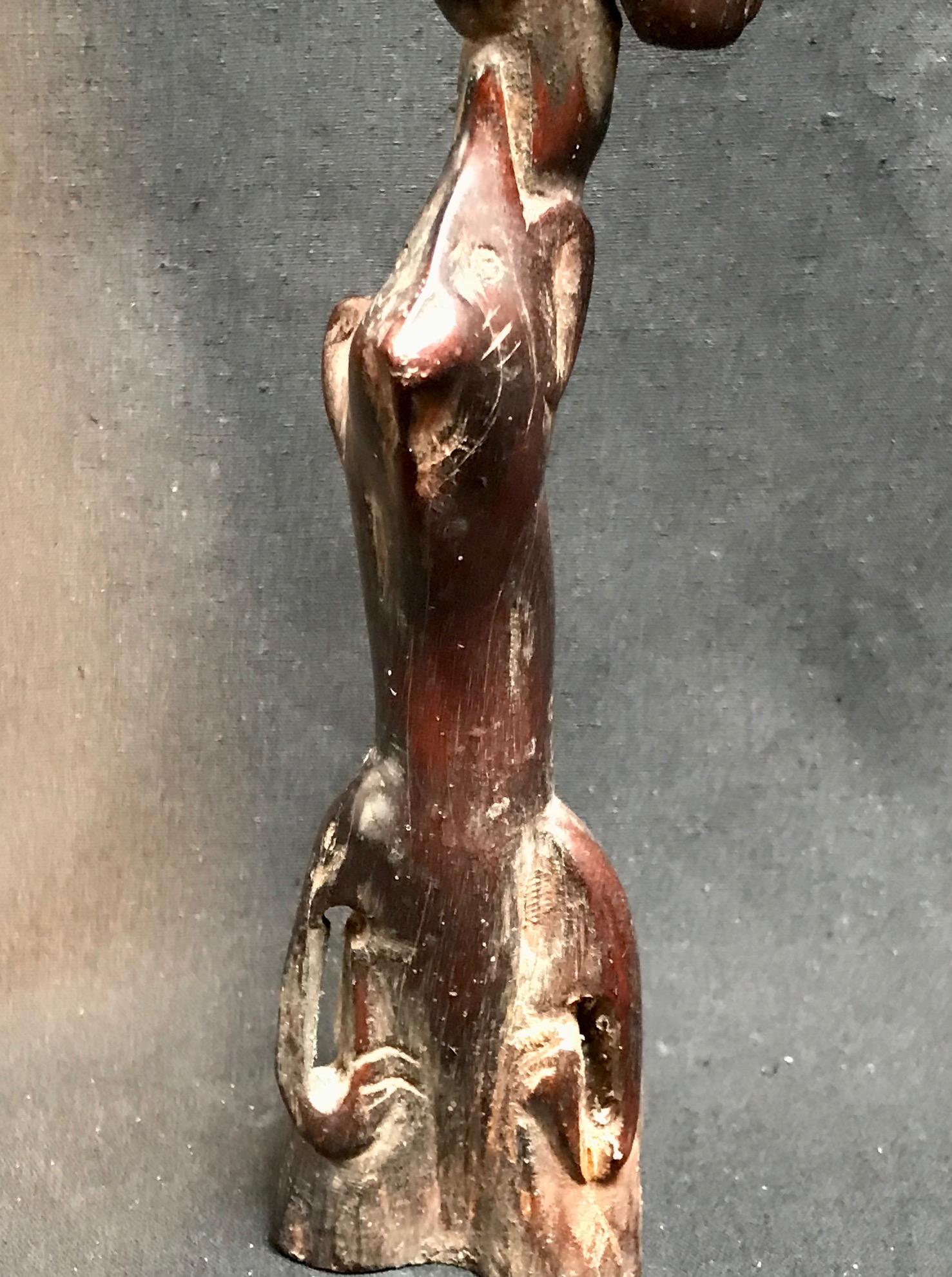"Detail of Shaman's Power Object/Healing Wand, Cat, Horse, Dog, Bird, Sumba Island, Indonesia, Early 20th c., wood, 9 1/2"" x 2 1/4"" x 2"""