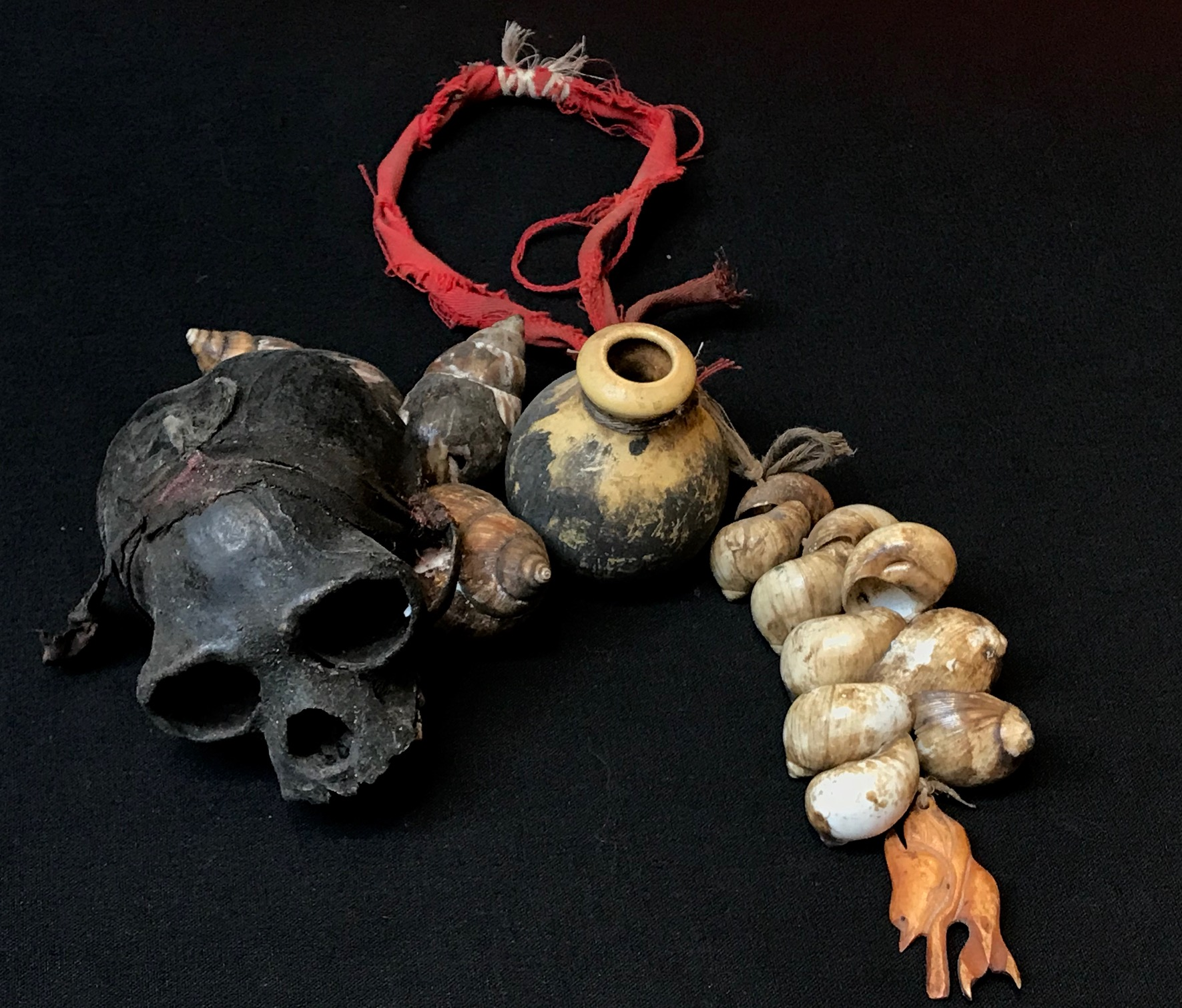 "Shaman's ritual dance rattle, Indonesia, Borneo, Dayak tribe, early 20th c., Monkey skull, sea shells, bone, ceramic beads, Shaken to scare away evil or harmful spirits, ~ 13"" x 5"""