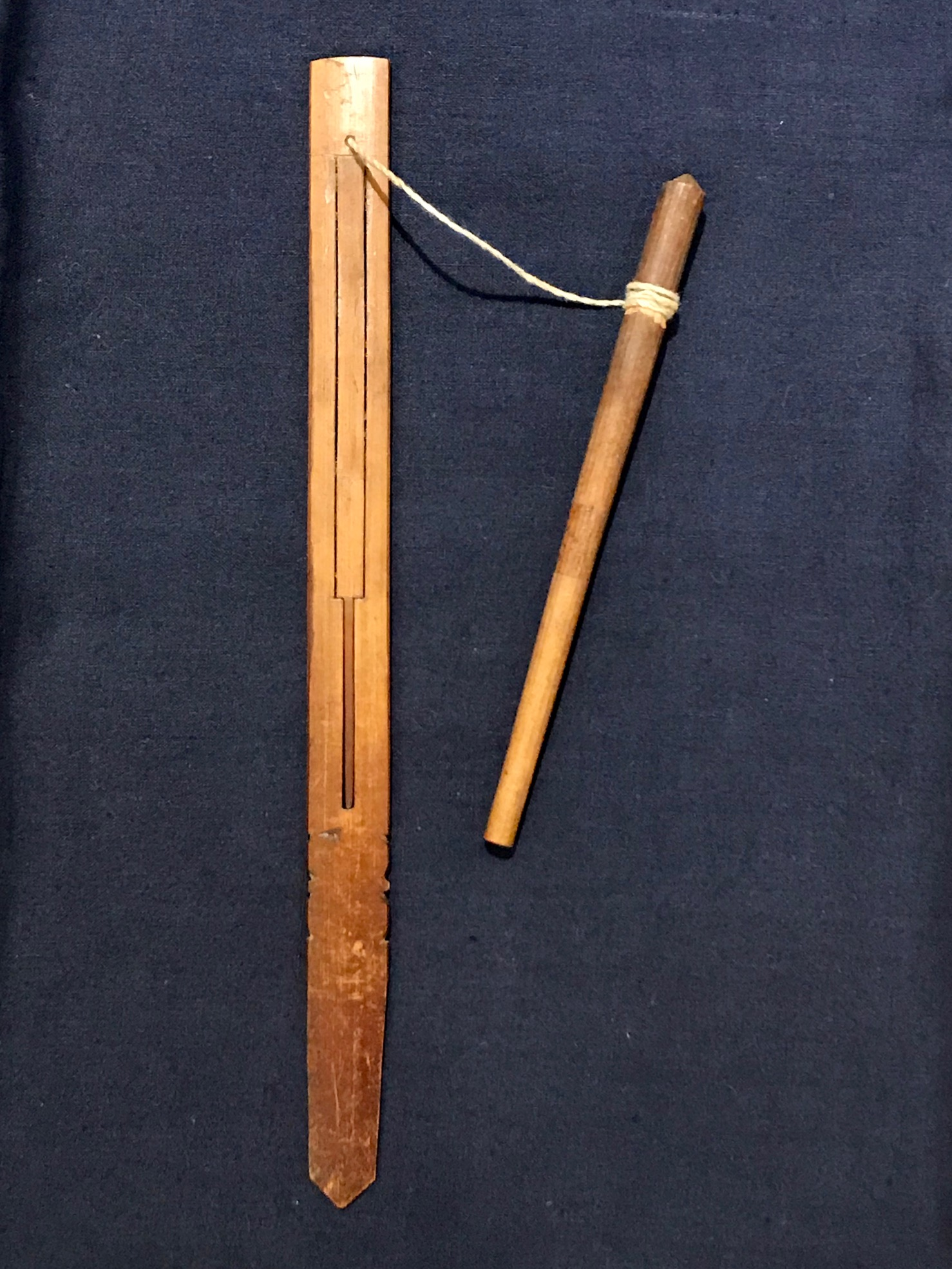 """Tribal Musical Instrument, Mouth Harp with pull stick, Sasak tribe, Lombok Island, Indonesia, Early to mid 20th c, bamboo, string, played by using the mouth as the resonating cavity and pulling the string to vibrate the bamboo. There are many traditional songs written for it. It has been referred to as a 'mind cleaner' Because it uses the mouth to resonate, it clears the brain of unclear thoughts. 7 3/4"""" x 5/8"""" x 1/8"""", pull stick - 4 3/4"""" x 1/4, sold, thedavidalancollection.com , solana beach, ca"""