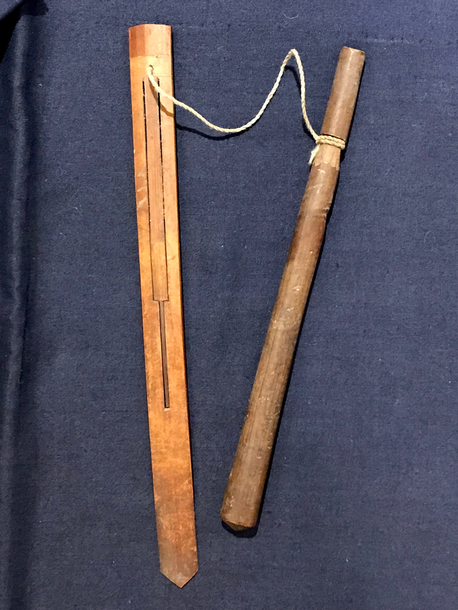 """Tribal Musical Instrument, Mouth Harp with pull stick, Sasak tribe, Lombok Island, Indonesia, Early to mid 20th c, bamboo, string, played by using the mouth as the resonating cavity and pulling the string to vibrate the bamboo. There are many traditional songs written for it. It has been referred to as a 'mind cleaner' Because it uses the mouth to resonate, it clears the brain of unclear thoughts. 7 1/2"""" x 5/8"""" x 1/8"""", pull stick - 6 3/4"""" x 3/8, $65., thedavidalancollection.com , solana beach, ca"""