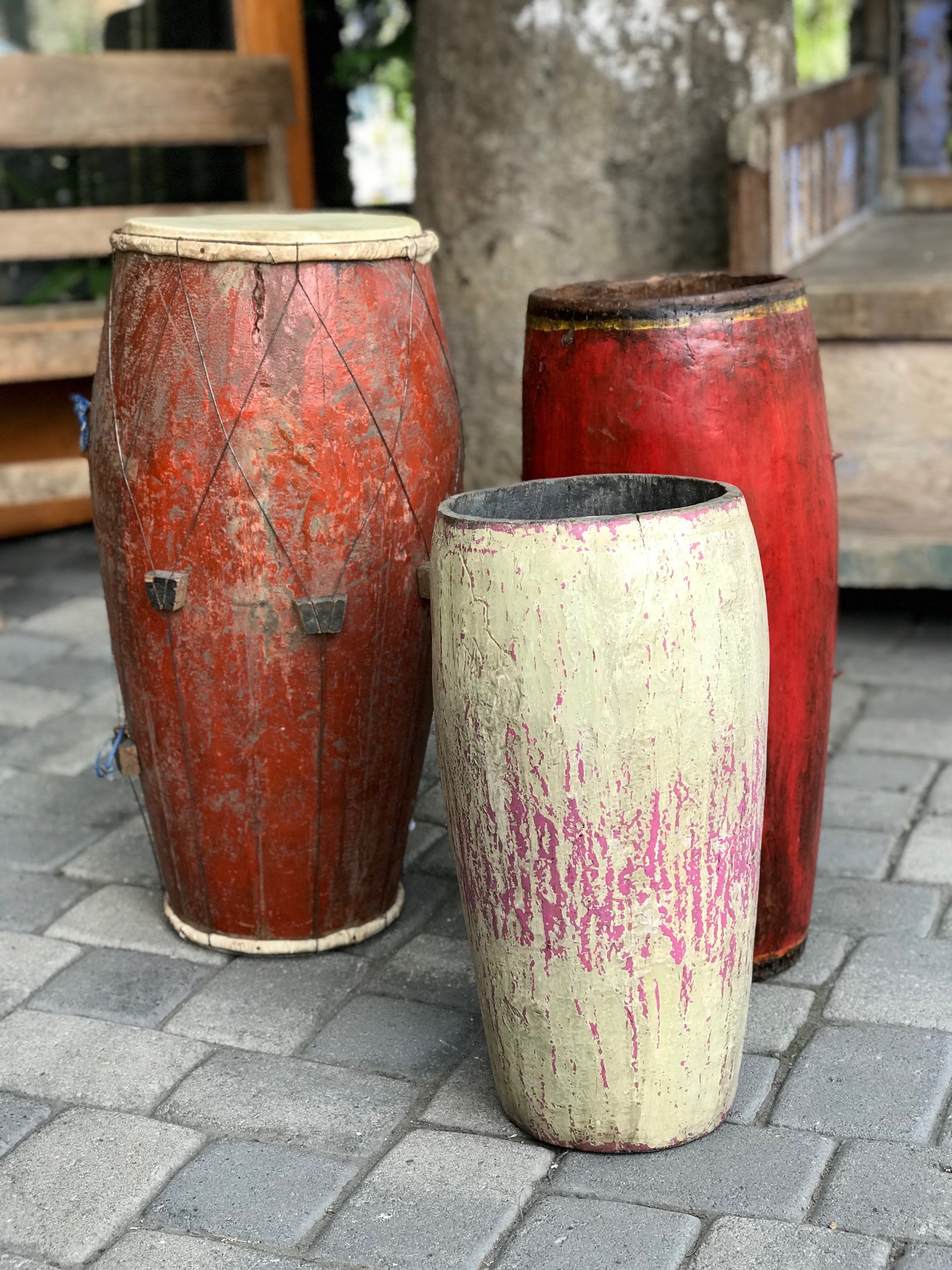 """Description Musical Instuments, Drums, wood, paint, hide skin, Indonesia, left to right - 27 1/2"""" x 16"""" $295.; white/front- 20 1/2"""" x 12"""", $225.; 25 1/2"""" x 13"""", $280., thedavidalancollection.com , solana beach, ca"""
