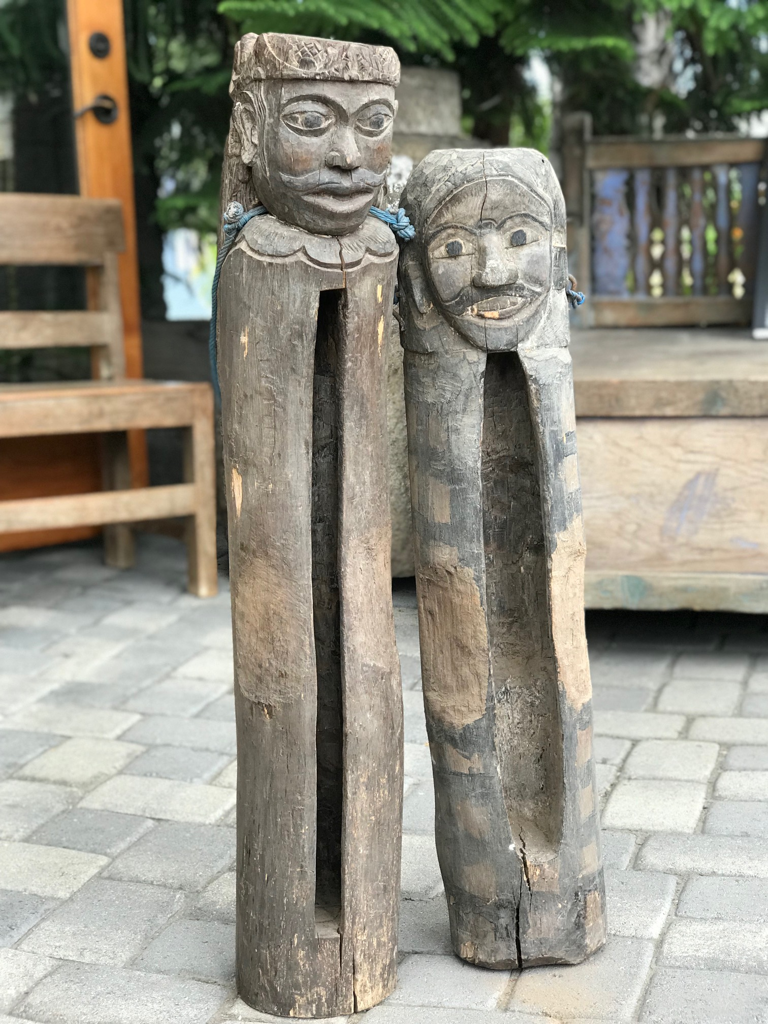 """Pair of Tribal Musical Instruments, Anthropomorphic Slit Drum or Gong, Kulkul, Bali, Indonesia, wood, paint, This type of percussion instrument was developed and used by people in forested areas as its sound will carry far through the surrounding jungle and rice fields. Often hung or placed in a drum pavilion or tower and used to call villagers to meetings, or other events by tapping out a signal. Left - 39 1/2"""" x 7 1/2"""" x 7"""", $950.; Right - 34 1/2"""" x 7"""" x 7"""", $590.; thedavidalancollection.com , solana beach, ca"""