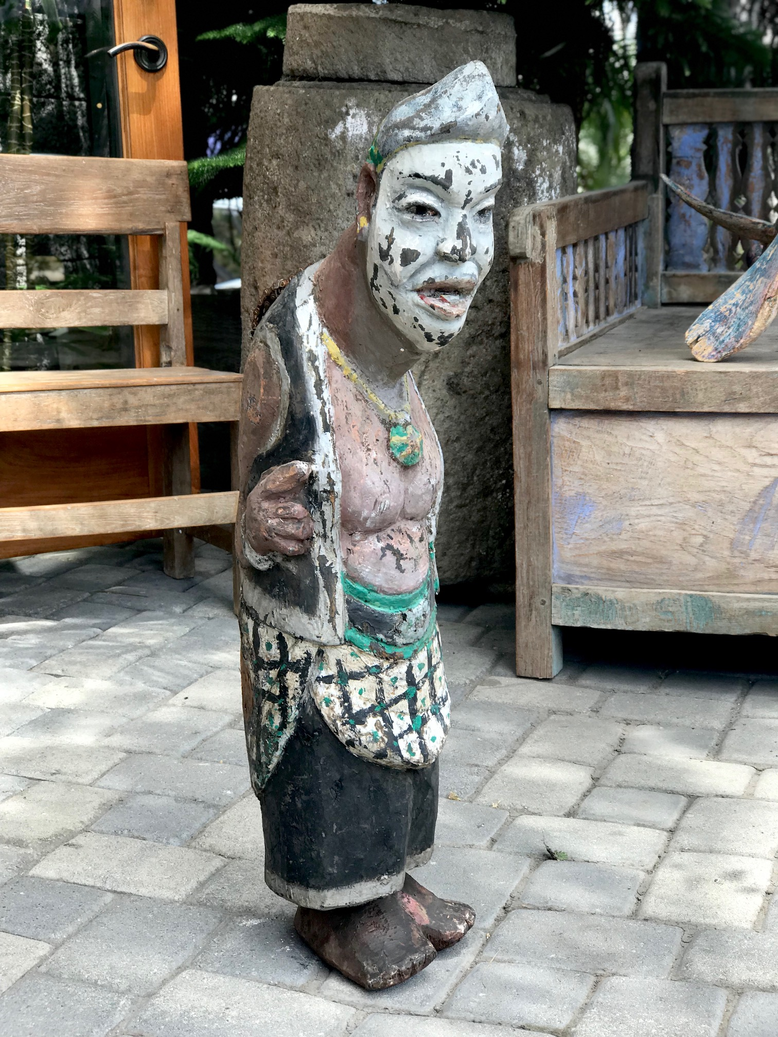 """Tribal Musical Instrument, Slit Drum/Gong, depicting Semar and important Javanese God/clown, Indonesia, wood, paint, bicycle chain handle, This type of percussion instrument was developed and used by people in forested areas as its sound will carry far through the surrounding jungle and rice fields. Often hung or placed in a drum pavilion or tower and used to call villagers to meetings, or other events by tapping out a signal. 36"""" x 10"""" x 12"""", $750., thedavidalancollection.com , solana beach, ca"""