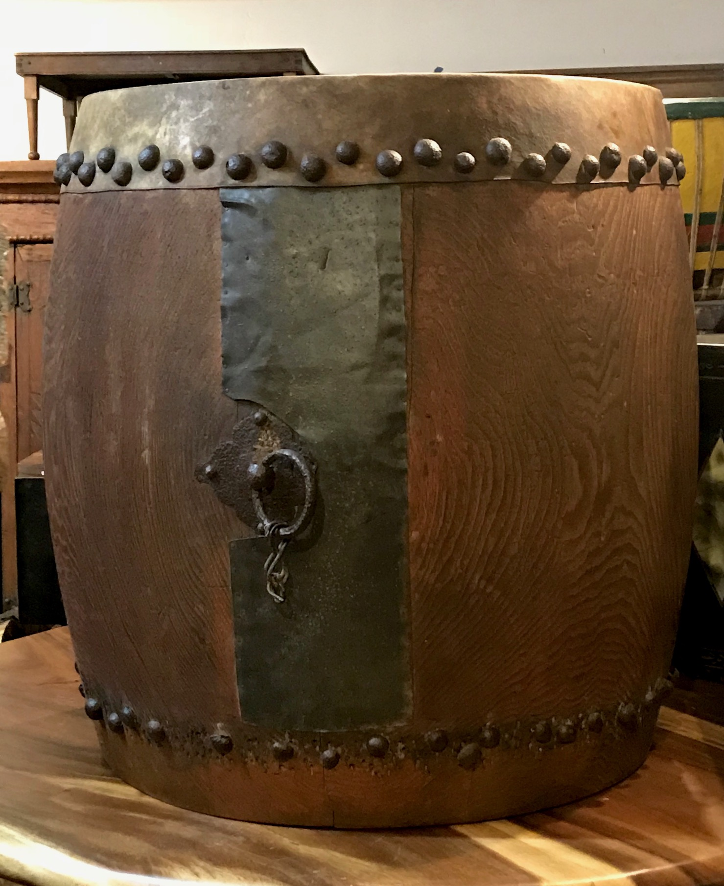 """Musical Instrument, Edo period Taiko Buddhist Drum, Japan, 18th c, keyaki wood (Japanese red elm), metal panel on side, metal tacks on rawhide skin (missing center of drum head skin on both sides) Metal ring with rope for carrying, 29 1/2"""" x 34"""", $2800. thedavidalancollection.com , solana beach, ca"""