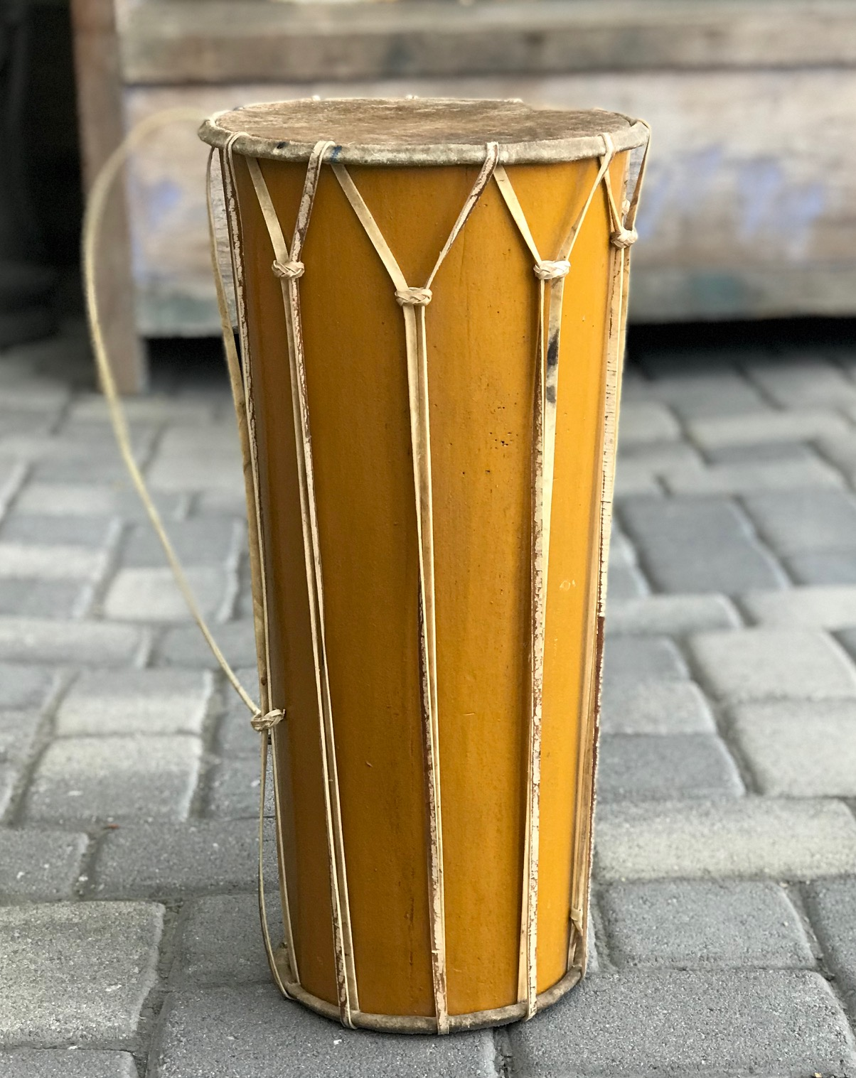 """Double Headed Drum, Java, Indonesia, hide skin heads with hide lacing and tuning straps. wood and paint with metal rings for carrying strap, contemporary, 21"""" x 10"""" (top) x 7 3/4"""" (bottom); $440. ; thedavidalancollection.com , solana beach, ca"""