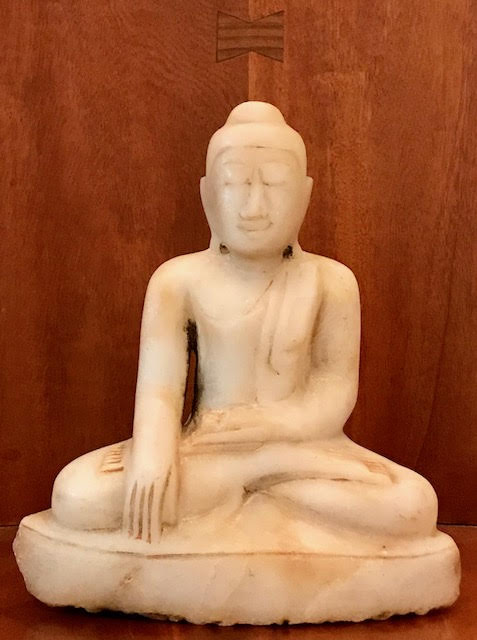 """Marble Buddha, Mandalay style, early 19th century. Hand carved in the lotus position (legs crossed with soles of feet up) and hands in 'Bhumisparsha mudra' or calling the earth to witness his moment of enlightenment position. His serene meditative face and monastic robes show great finesse. In excellent condition, wear is consistent with age and use. Dimensions: 9 1/4"""" tall x 8 1/4 wide x 5"""" deep"""