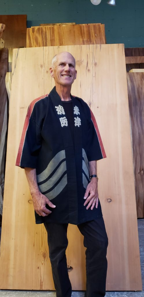 Japanese traditional Fireman's Hanten Coat, or Utility Jacket. It is a heavy durable hand woven fabric and Indigo dyed. It often has a symbol on the back which would be the name of the district's fire brigade. Additional writing on the front would tell more about that brigade. this one is about 70 years old, vintage but unused and in perfect condition.