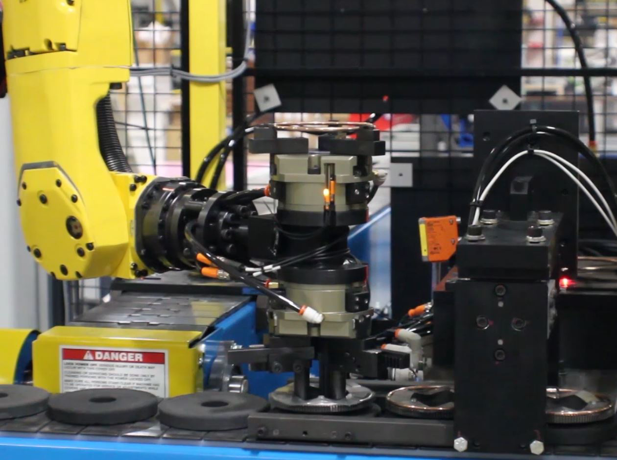A Fanuc robot provided by CNC Solutions assembling different parts