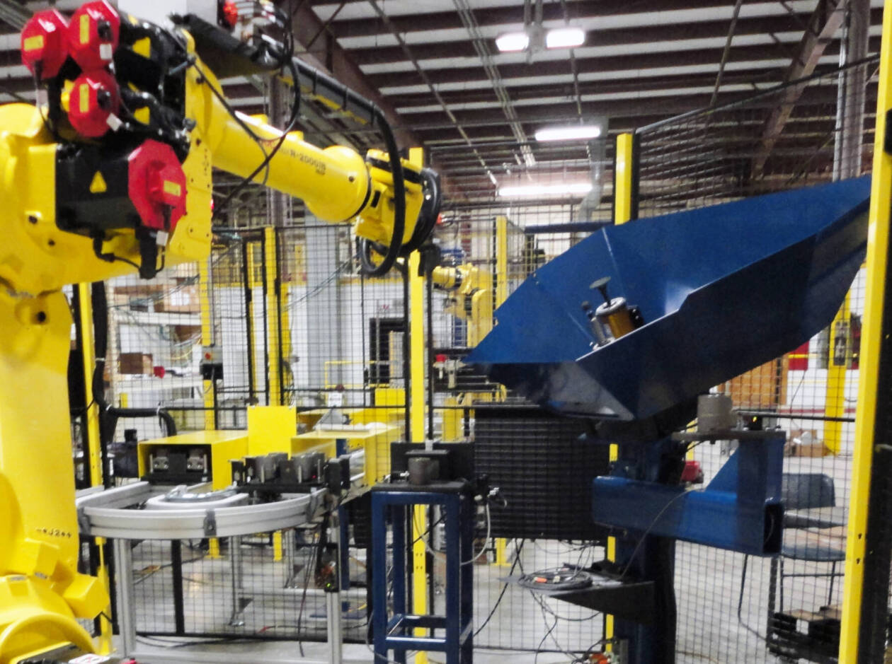 CNC Solutions LLC Fanuc robot performing material removal