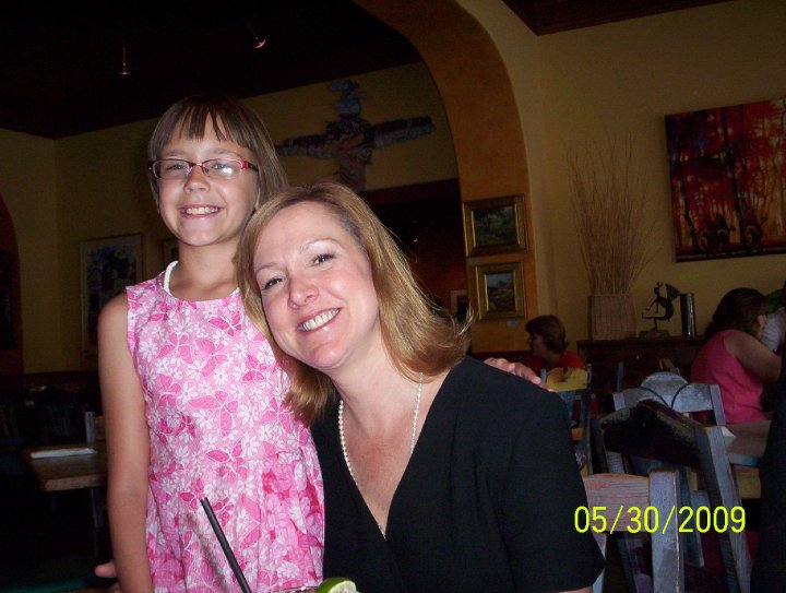 Here I am (in the pink dress) with my Aunt Lynne at my grandfather and her father's funeral in 2009.
