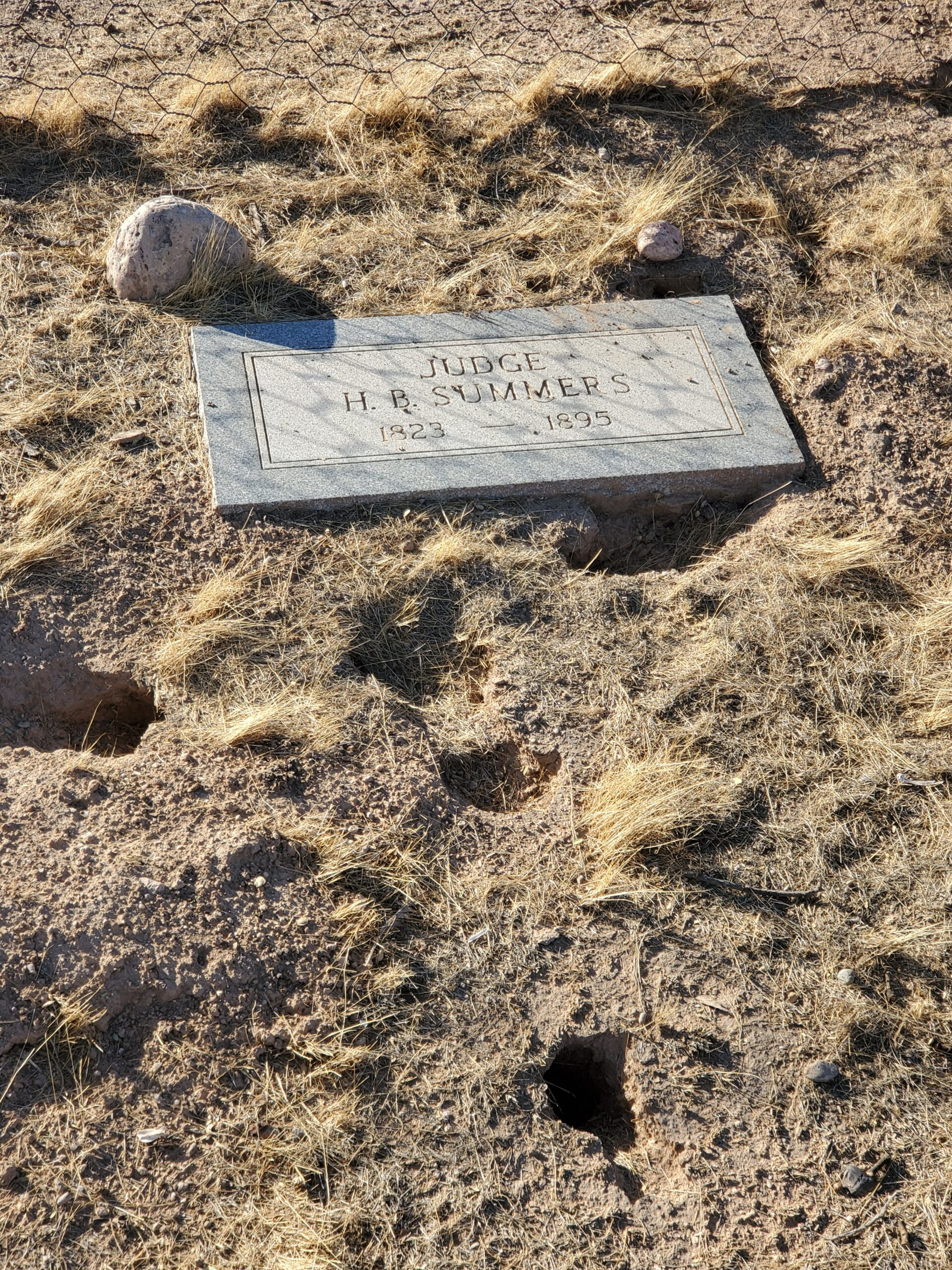 This simple headstone marks the final resting place of a judge from before Arizona became a state