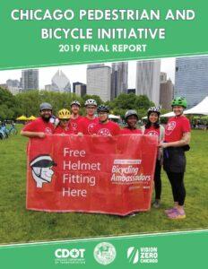 2019 Bike Ambassadors holding sign advertising free helmet fittings.