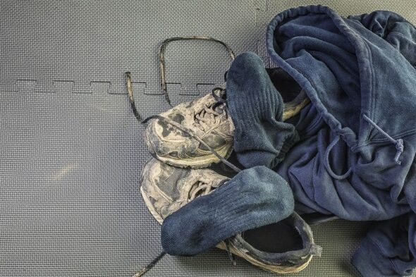 Dry-Mud-Running-Sneakers-Pile-of-Workout-Clothes-cm
